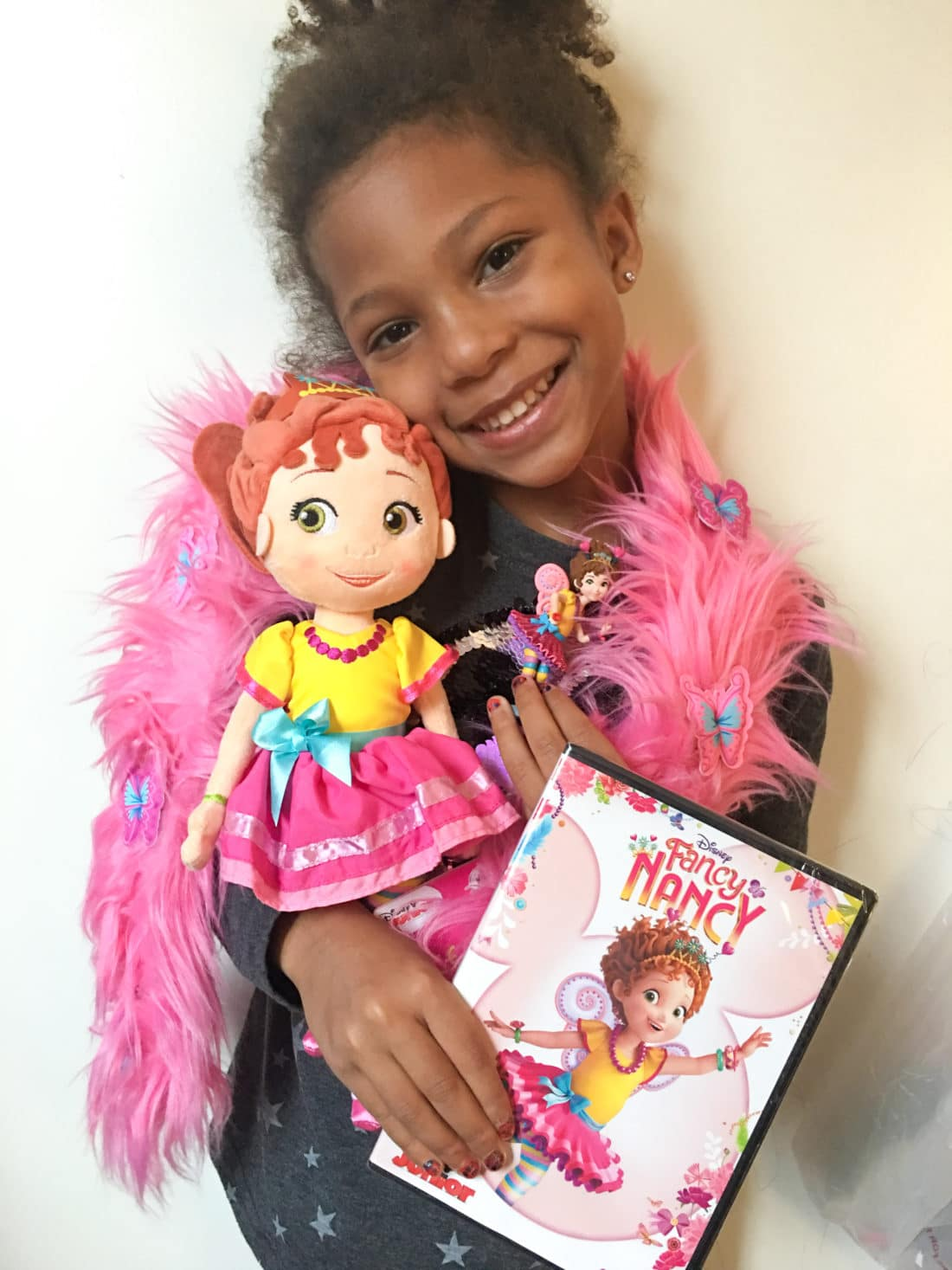 """Esuun Fancy Nancy DVD Doll Figure. Grab some glitter, add a dash of """"ooh la la,"""" sprinkle in original songs and Voilà! Get set to pour on the fun with Fancy Nancy in her newest DVD from Disney Junior."""