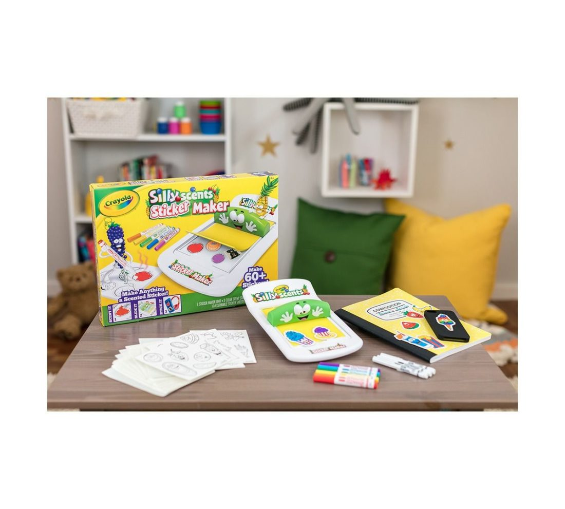 The Crayola Silly Scents Sticker Maker lets you turn almost anything into a custom sticker. To start creating your own DIY stickers just place an adhesive sheet on the sticker bed and place a magazine picture or the included line art on top.