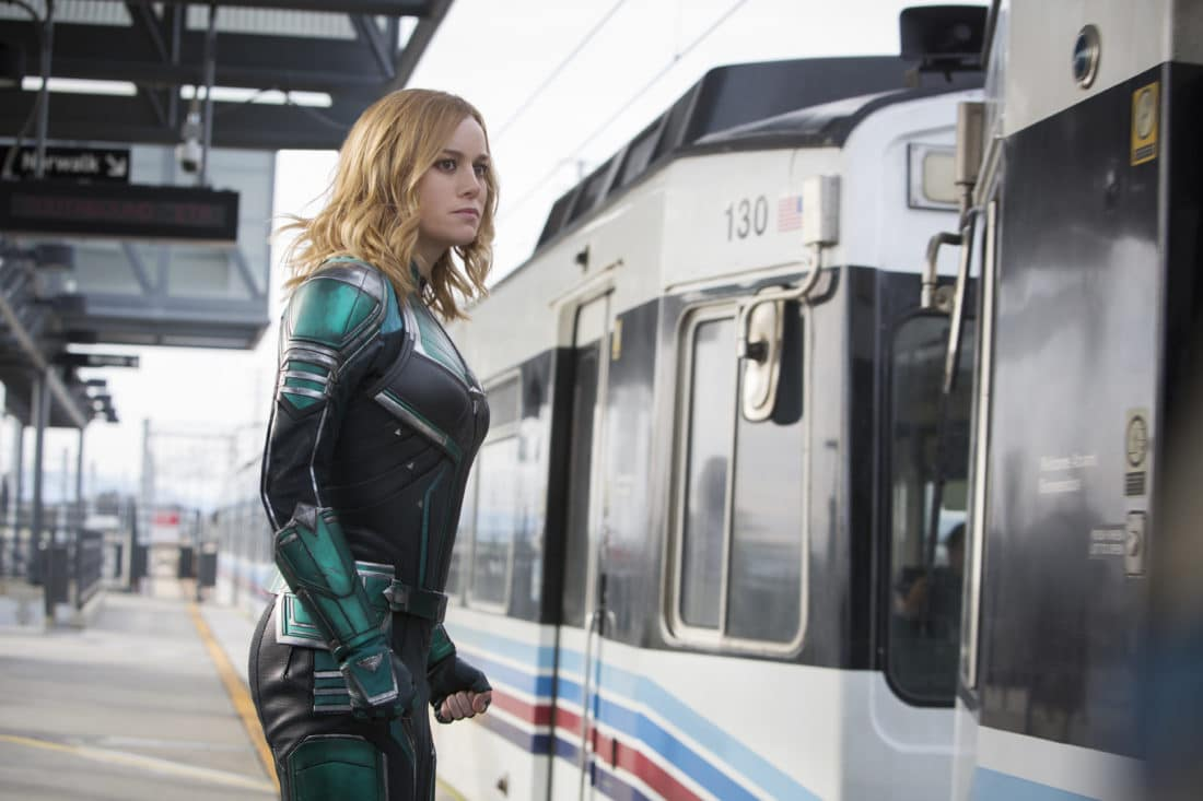 Marvel Studios Captain Marvel In Train Station. Set in the 1990s, Marvel Studios'CAPTAIN MARVELis an all-new adventure from a previously unseen period in the history of the Marvel Cinematic Universe that follows the journey of Carol Danvers as she becomes one of the universe's most powerful heroes.