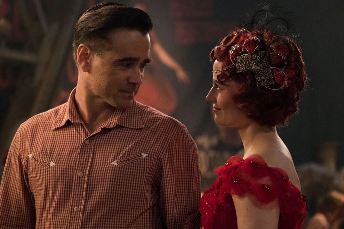 """In Tim Burton's all-new, live-action reimagining of """"Dumbo,"""" former circus star Holt Farrier (Colin Farrell) is tapped to care for a newborn elephant with oversized ears. Dumbo flies into theaters on March 29, 2019."""