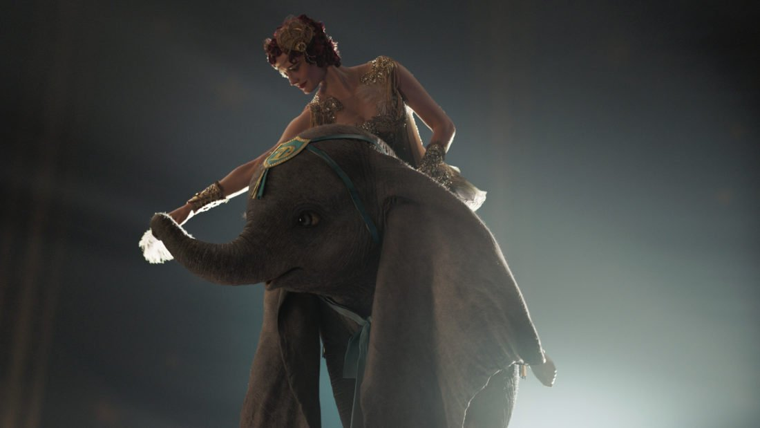 """In Disney's live-action reimagining of """"Dumbo,"""" accomplished aerialist Colette Marchant is paired with a flying elephant named Dumbo in a new act at a state-of-the-art amusement park called Dreamland. Starring Eva Green as Colette, """"Dumbo"""" opens in U.S. theaters on March 29, 2019."""