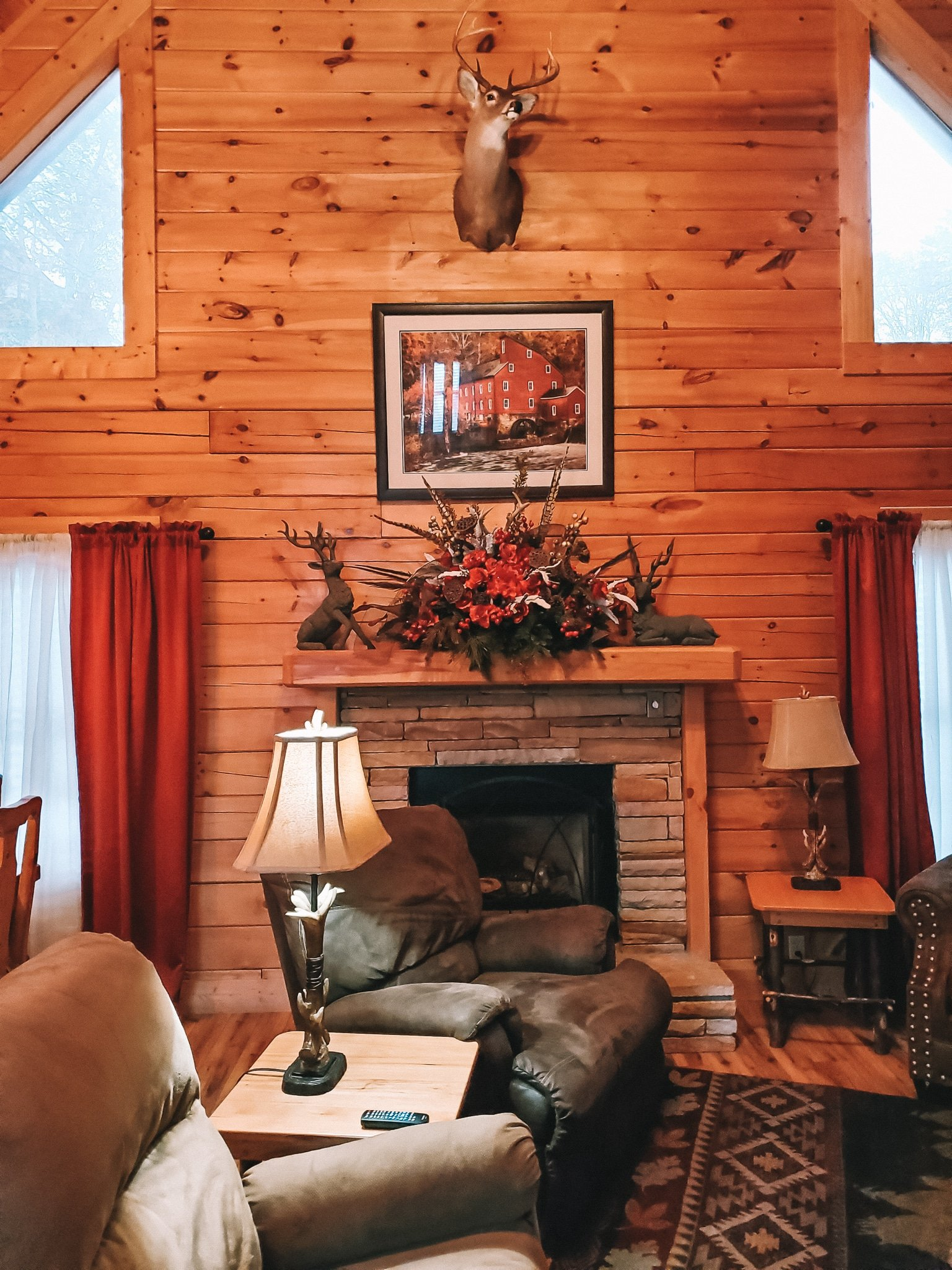 The Mountain Charm Eagles Ridge Resorts Cabin Living Room. The Mountain Charm 3 Bedroom Cabin at Eagles Ridge Resort offers ample space and luxury. The perfect place to stay during a family vacation to Pigeon Forge, TN.