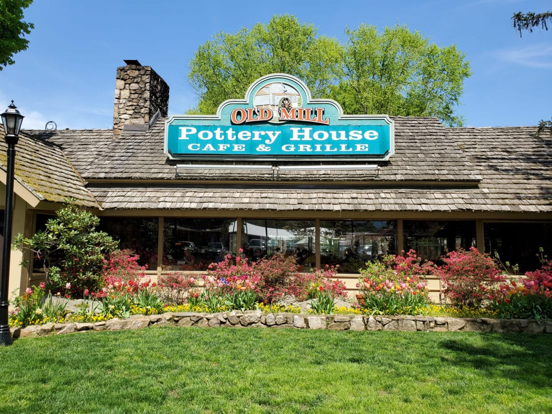 The Old Mill Pottery House Cafe & Grille Front Sign. The Pottery House Cafe serves freshly made sandwiches, salads, and hearty entrees on dishes created by our potters right next door. Read my full review which includes photos of this beautiful and delicious location in Pigeon Forge, TN.