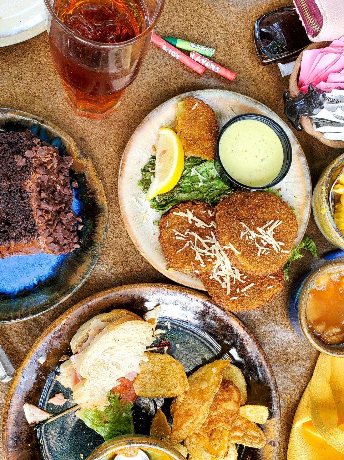 The Old Mill Pottery House Cafe & Grille Table Spread. The Pottery House Cafe serves freshly made sandwiches, salads, and hearty entrees on dishes created by our potters right next door. Read my full review which includes photos of this beautiful and delicious location in Pigeon Forge, TN.