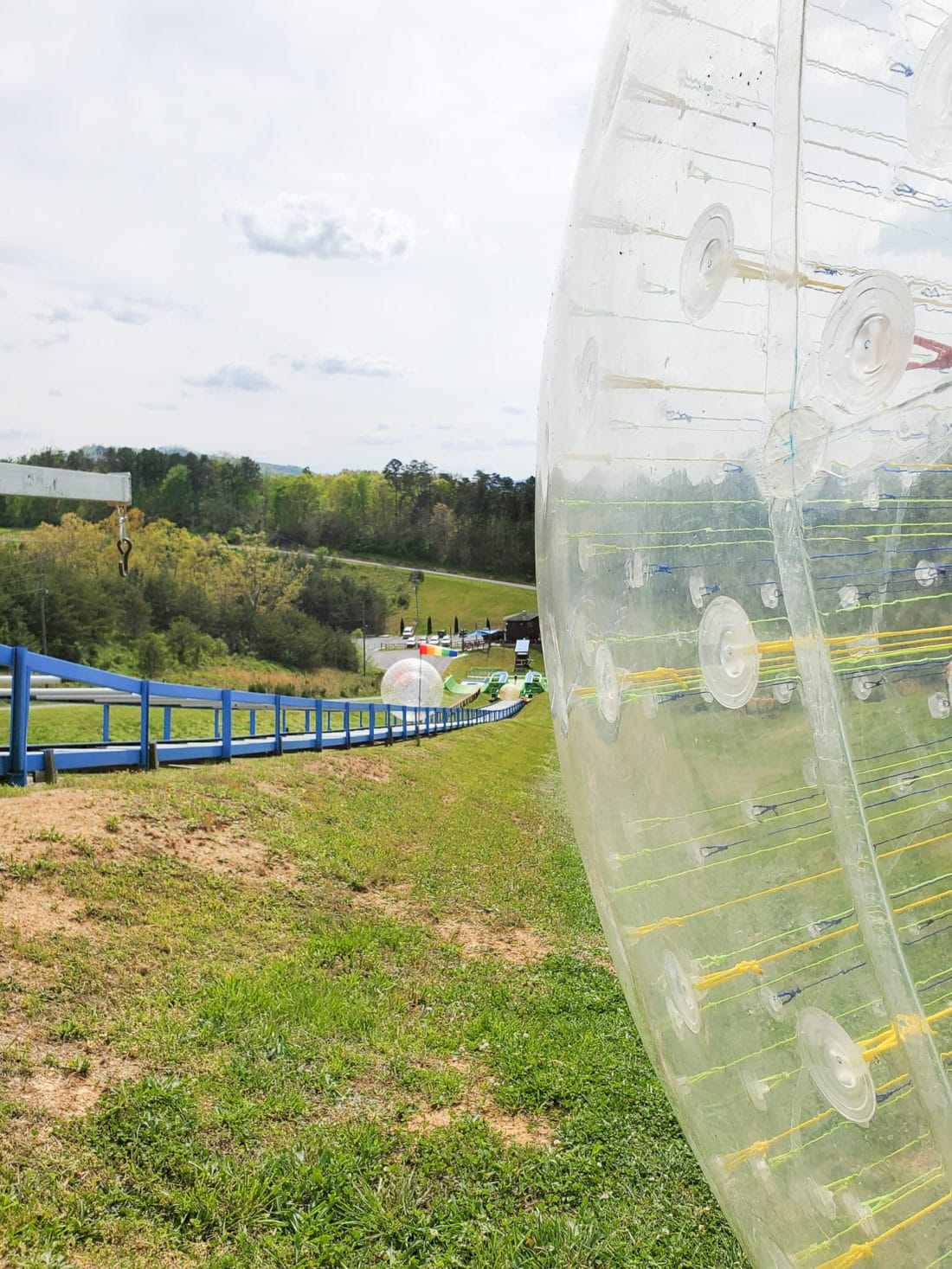 Outdoor Gravity Park Fast Track Closeup. Outdoor Gravity Park is an amazing adventure destination in Pigeon Forge, Tennessee at the foothills of the Smoky Mountains featuring zorbing, an attraction straight out of New Zealand.