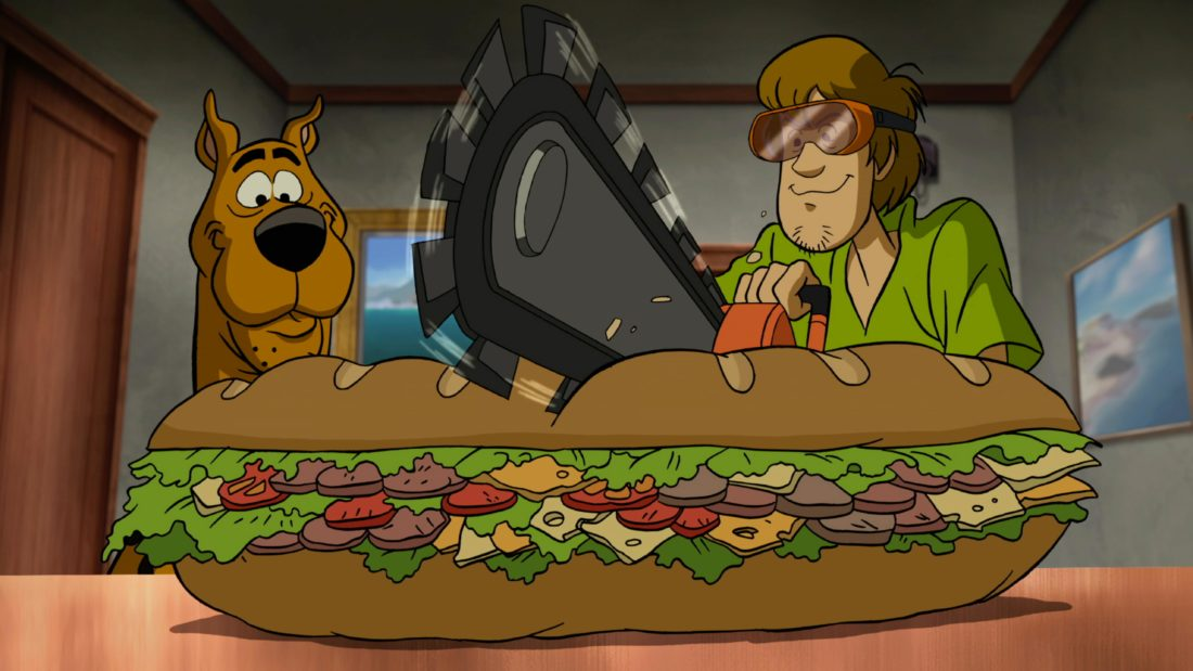 Scooby Doo Return To Zombie Island Sandhich. Pack your Scooby Snacks and join the Mystery Inc. gang as the teen sleuths embark on a wild and spooky vacation with zombies and cat people onScooby-Doo! Return to Zombie Island,an all-new, original film. Available on Digital and DVD October 1rst, 2019.