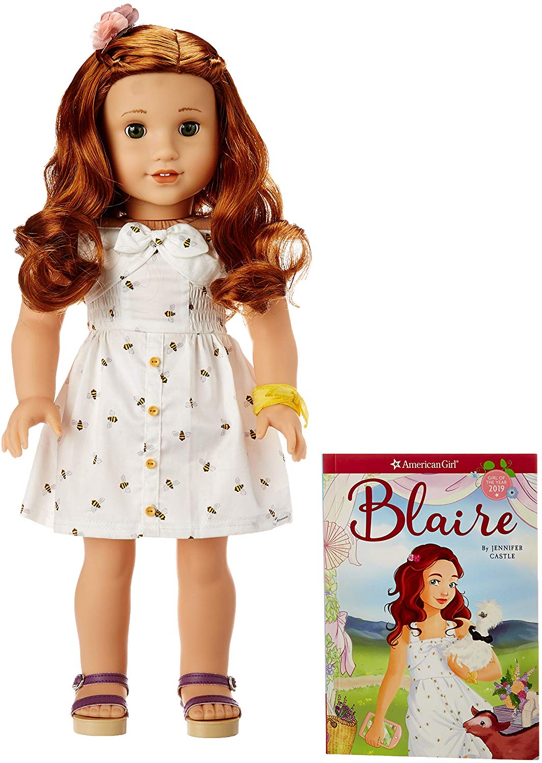 """American Girl Doll Blaire. Meet Blaire, the 2019 Girl of the Year! She's a chef-in-training, party planner, and chicken wrangler at her family's farm and restaurant. The 18"""" Blaire doll has bright green eyes that open and close, and curly red hair. She has a huggable cloth body, and her movable head and limbs are made of smooth vinyl. She comes with the Blaire paperback book, plus her signature outfit:"""