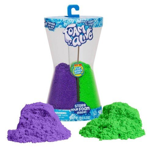 """Double the fun with the Foam Alive Double Flip Pack! It contains two Foam Alive colors - Purple Pulse and Go Go Green in a cool hour-glass shaped reusable storage container. Flip it to flow and watch it go! It magically comes to life! Foam Alive is soft, squishy, fluffy foam that mysteriously moves in """"Flow Motion""""."""