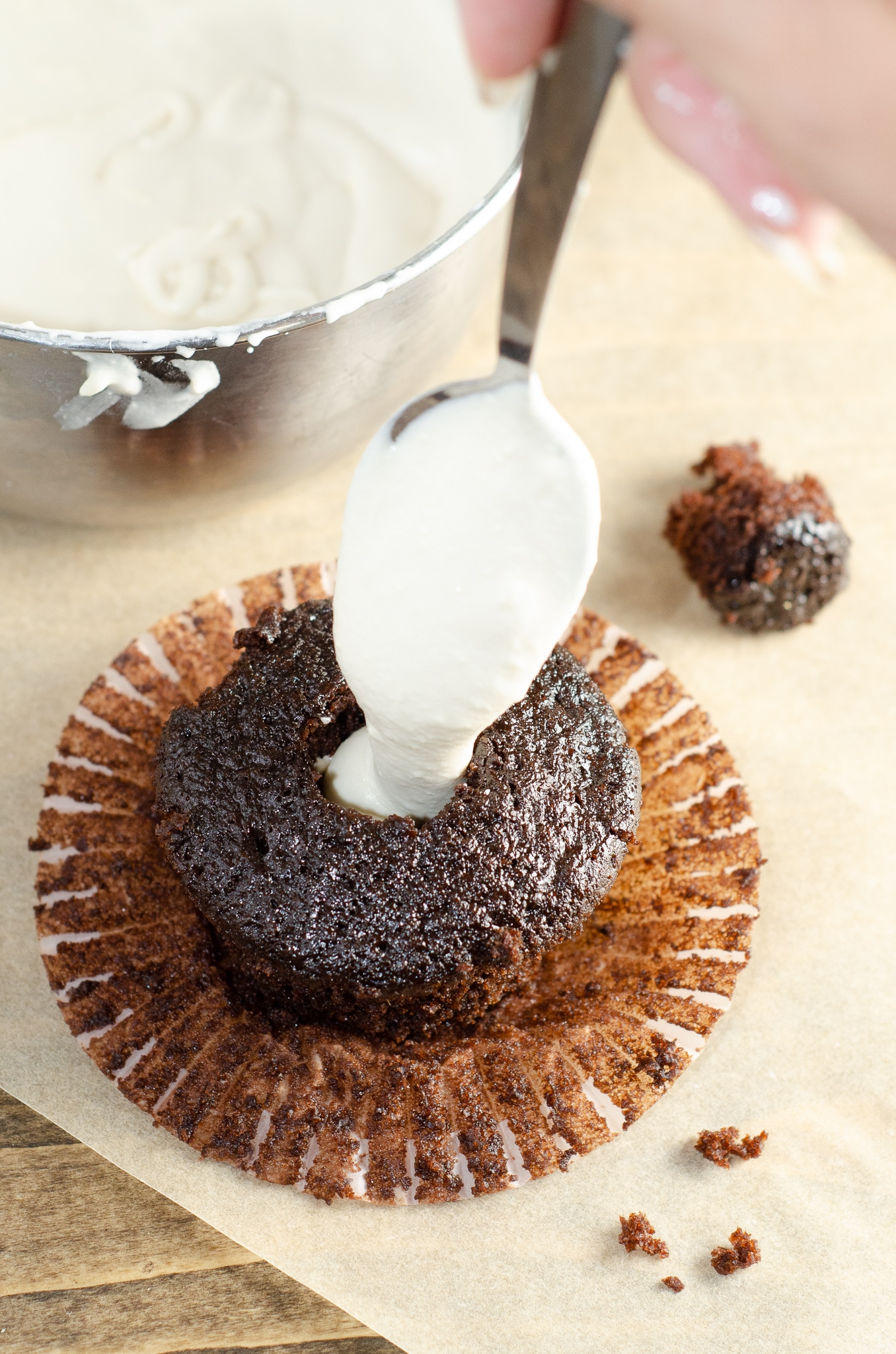 Chocolate Cupcake with Marshmallow Creme Filling. Sink your teeth into a childhood favorite cupcake that is as easy to bake as it is to eat. My Chocolate cupcakes with Chocolate Buttercream frosting and marshmallow creme filling will make the kid in you cheer.