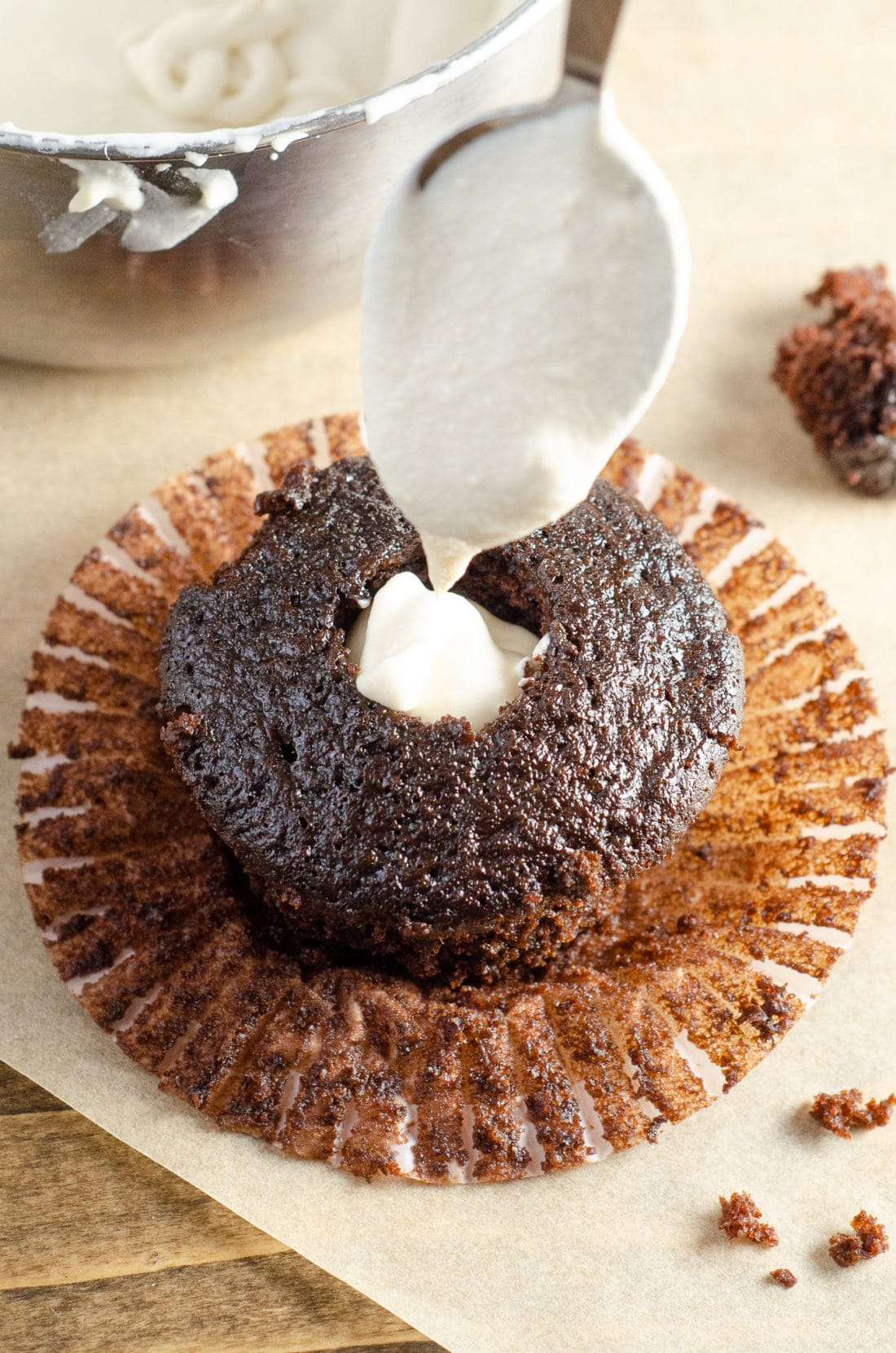 Chocolate Cupcake with Marshmallow Creme Filling Added. Sink your teeth into a childhood favorite cupcake that is as easy to bake as it is to eat. My Chocolate cupcakes with Chocolate Buttercream frosting and marshmallow creme filling will make the kid in you cheer.