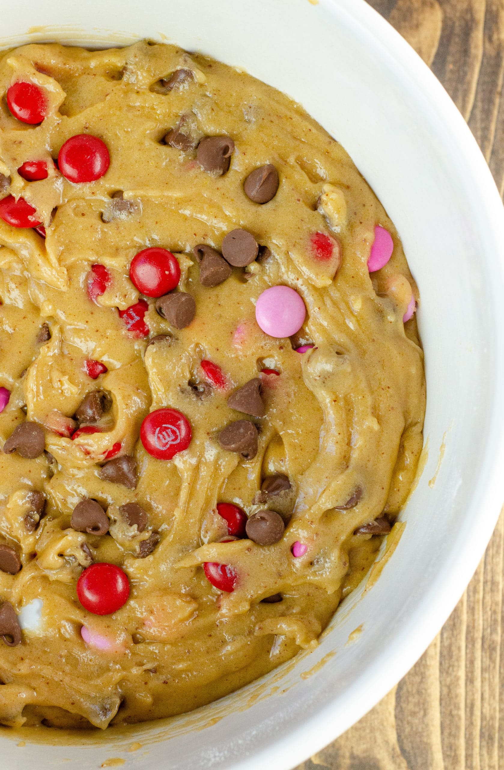 Browned Butter M&M Blondies Dough. These Valentine's day themed Browned Butter M&M Blondies are the perfect way to say I heart you to someone special. I love to bake them for my little ones year-round. They are so chewy and chocolatey they make it easy for me to look like a master dessert chef.