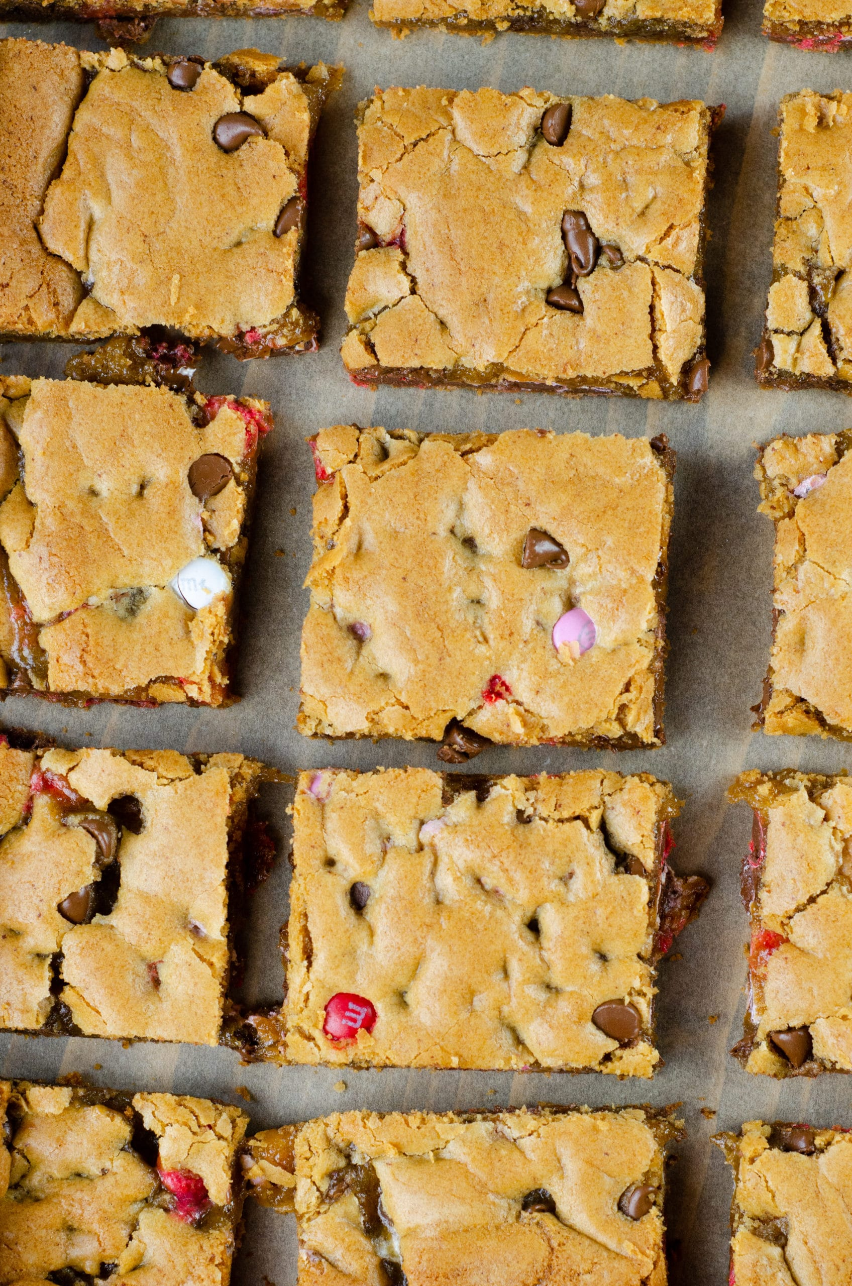 Browned Butter M&M Blondies Bars. These Valentine's day themed Browned Butter M&M Blondies are the perfect way to say I heart you to someone special. I love to bake them for my little ones year-round. They are so chewy and chocolatey they make it easy for me to look like a master dessert chef.