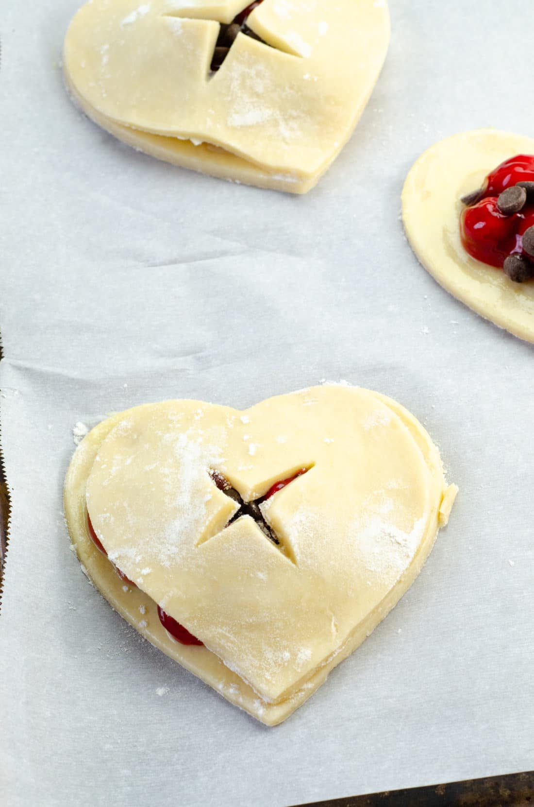 Chocolate Cherry Hand Pies Butter Pie Crust. Say I heart you to someone special this Valentine's Day with a delicious homemade treat. Try my super easy to make Chocolate Cherry Hand Pies which include a from scratch buttery flaky pie crust.