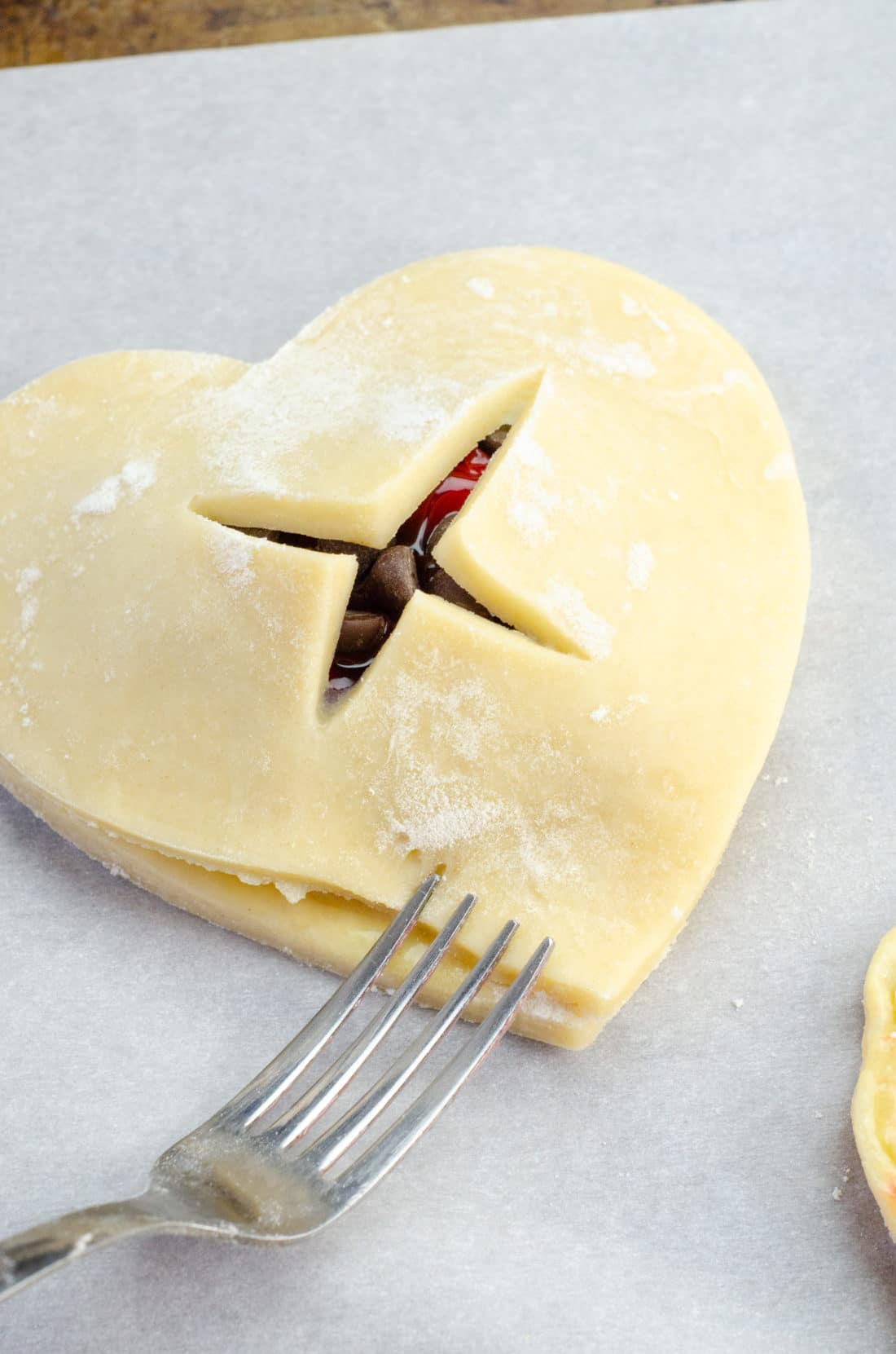 Chocolate Cherry Hand Pies Being Closed. Say I heart you to someone special this Valentine's Day with a delicious homemade treat. Try my super easy to make Chocolate Cherry Hand Pies which include a from scratch buttery flaky pie crust.