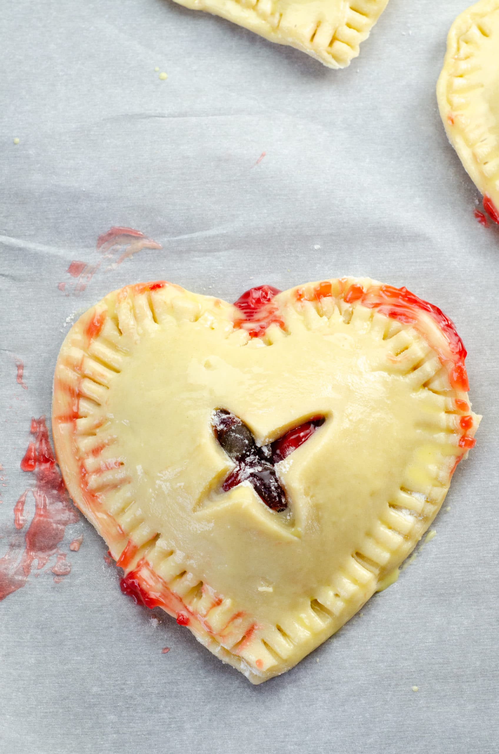 Chocolate Cherry Hand Pies Egg Wash. Say I heart you to someone special this Valentine's Day with a delicious homemade treat. Try my super easy to make Chocolate Cherry Hand Pies which include a from scratch buttery flaky pie crust.