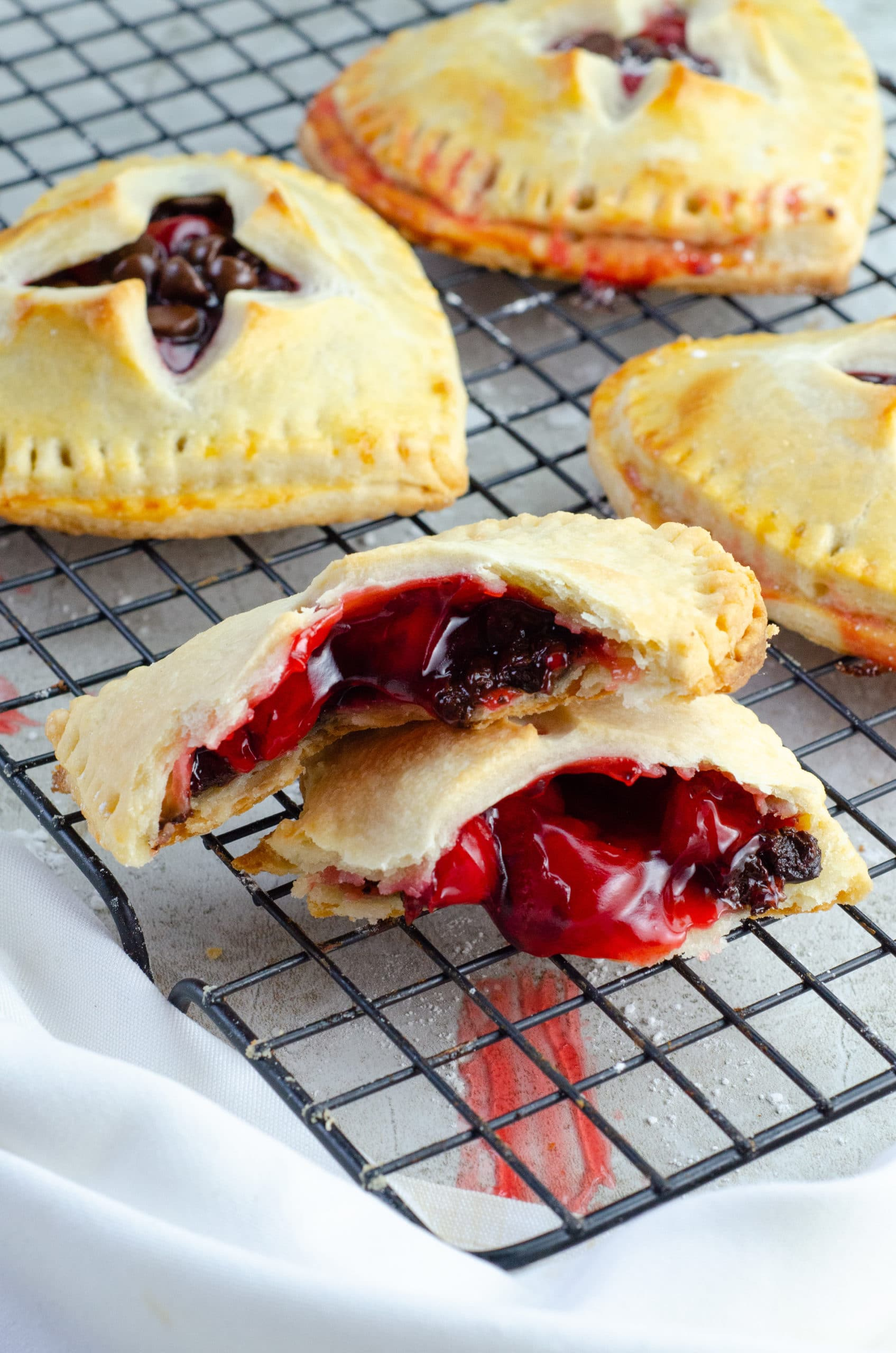 Chocolate Cherry Hand Pies Opened. Say I heart you to someone special this Valentine's Day with a delicious homemade treat. Try my super easy to make Chocolate Cherry Hand Pies which include a from scratch buttery flaky pie crust.