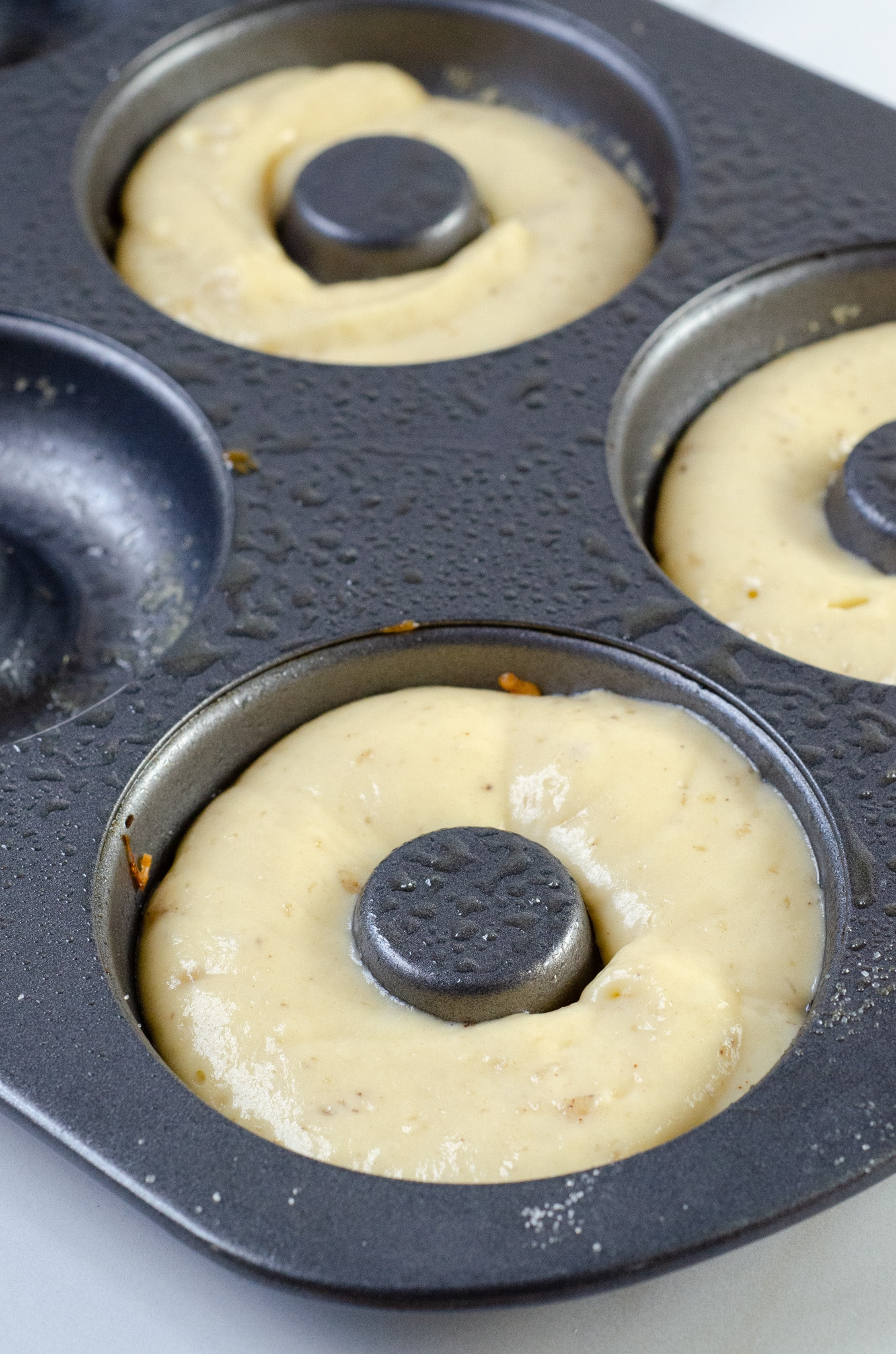 Baked Vanilla Donuts Baking Tray. Baked Vanilla Donuts are perfect for any occasion, Valentine's Day treats or birthday sweets, the possibilities are endless.