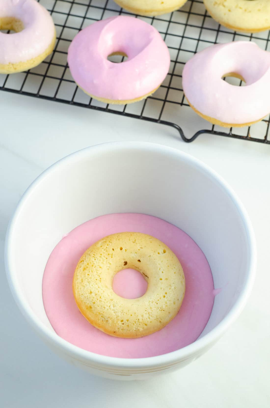 Baked Vanilla Donuts Dropped In Vanilla Glaze. Baked Vanilla Donuts are perfect for any occasion, Valentine's Day treats or birthday sweets, the possibilities are endless.
