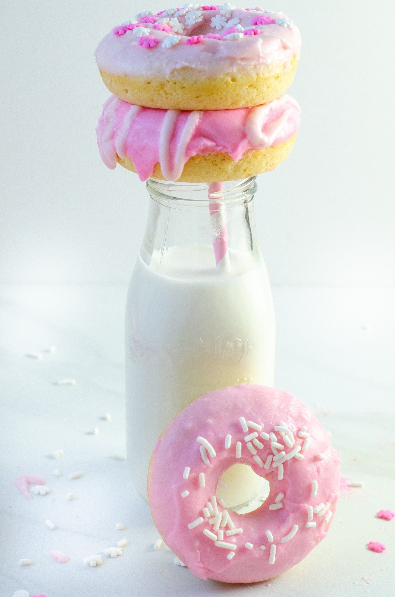 Baked Vanilla Donuts Milk Stack. Baked Vanilla Donuts are perfect for any occasion, Valentine's Day treats or birthday sweets, the possibilities are endless.
