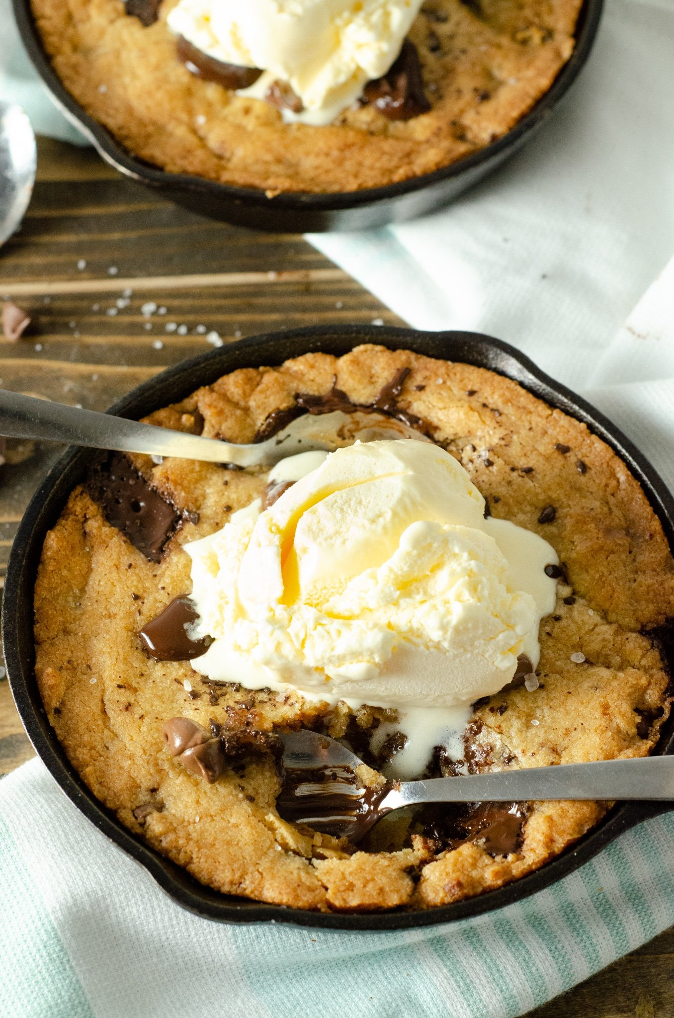 Chocolate Chip Skillet Cookie. This brown butter Chocolate Chip Skillet Cookie is packed with chunks of chocolate and topped with sea salt, it's the perfect dessert for two. The insanely soft center and crispy buttery edges will have you falling in love with this easy pizookie recipe.