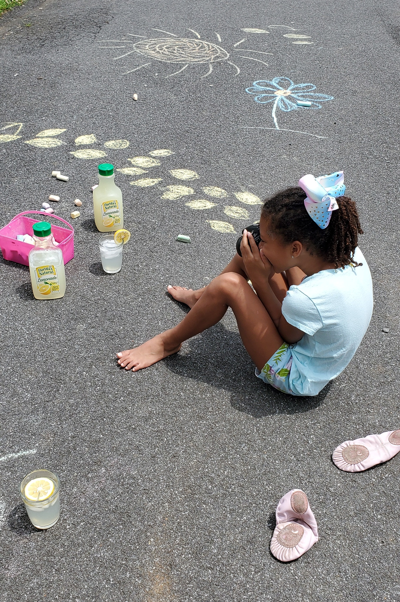 Lemonade Art Esuun Taking Photo. Looking for a fun way to keep the kids entertained this summer? Celebrate the start of summer with Lemonade-Inspired Art In the Backyard.
