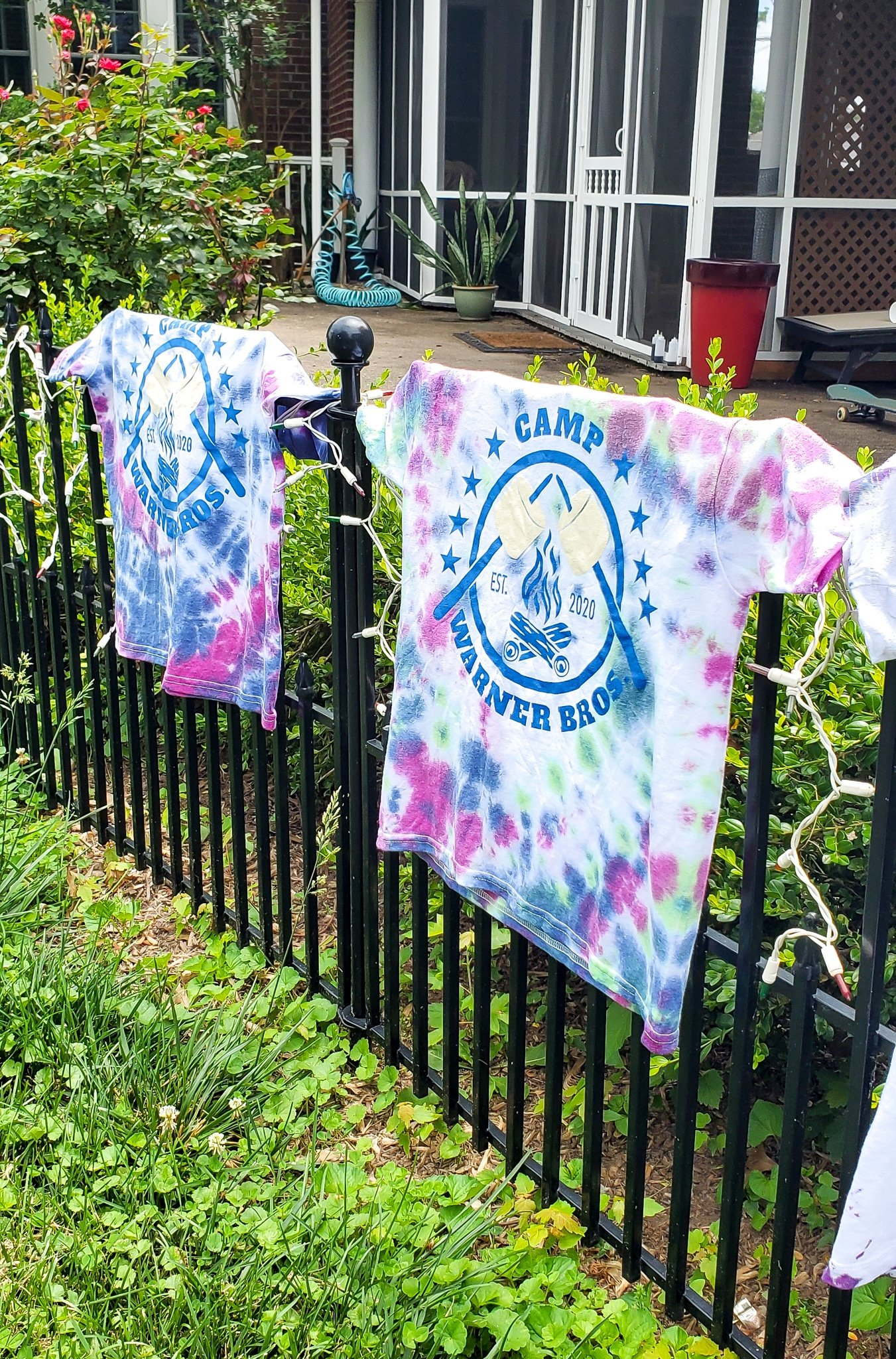 Camper Warner Bros. Tie-Dye Camper Shirts Drying. Join us as we adventure through 8 weeks of Virtual Camp Warner Bros. Each week will feature a new fun family friendly activity and a Warner Bros. Show or Movie. This week featured a Camper Shirt Tie-Dye activity.