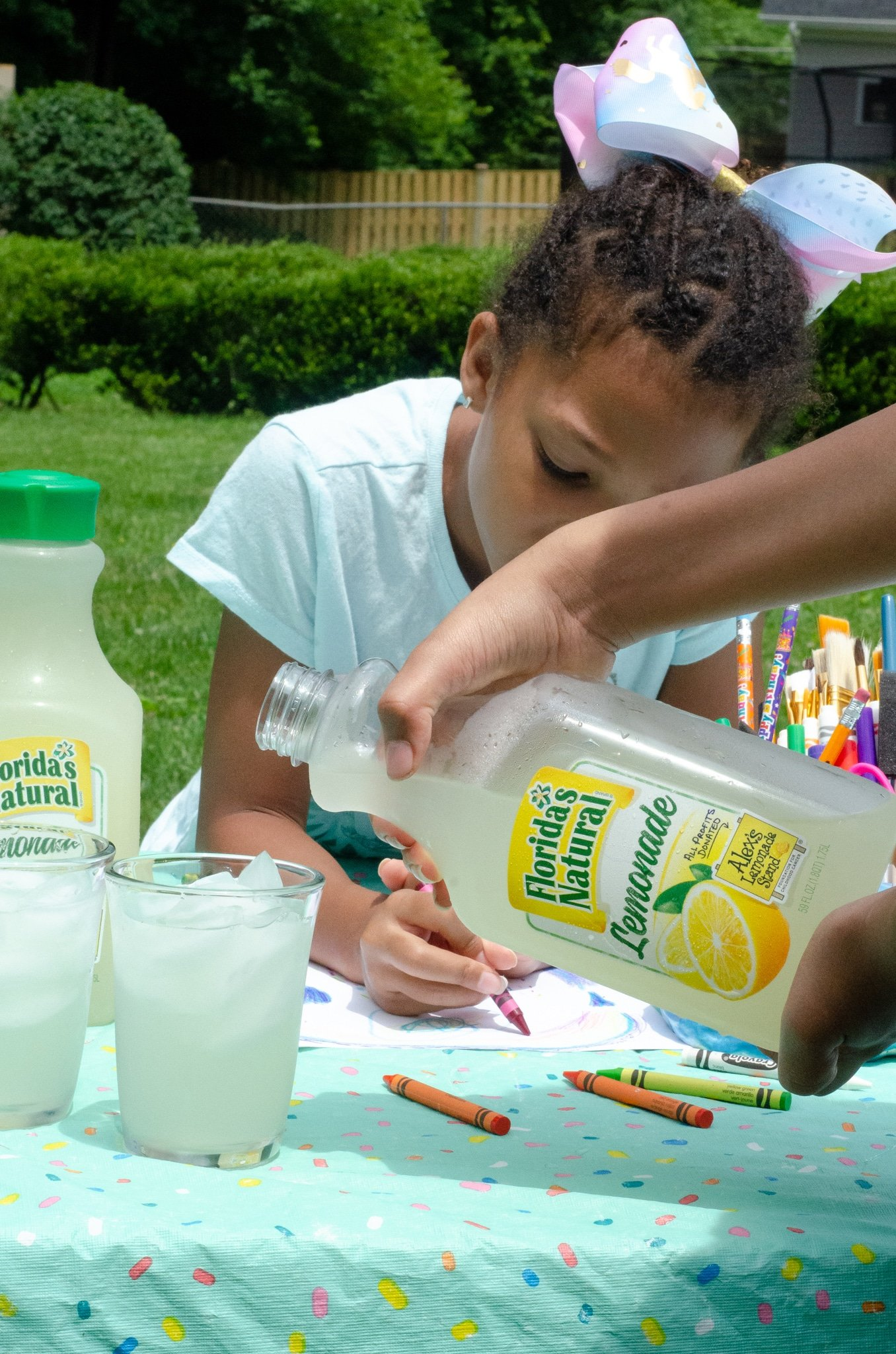Lemonade Inspired Art Pouring Lemonade. Looking for a fun way to keep the kids entertained this summer? Celebrate the start of summer with Lemonade-Inspired Art In the Backyard.