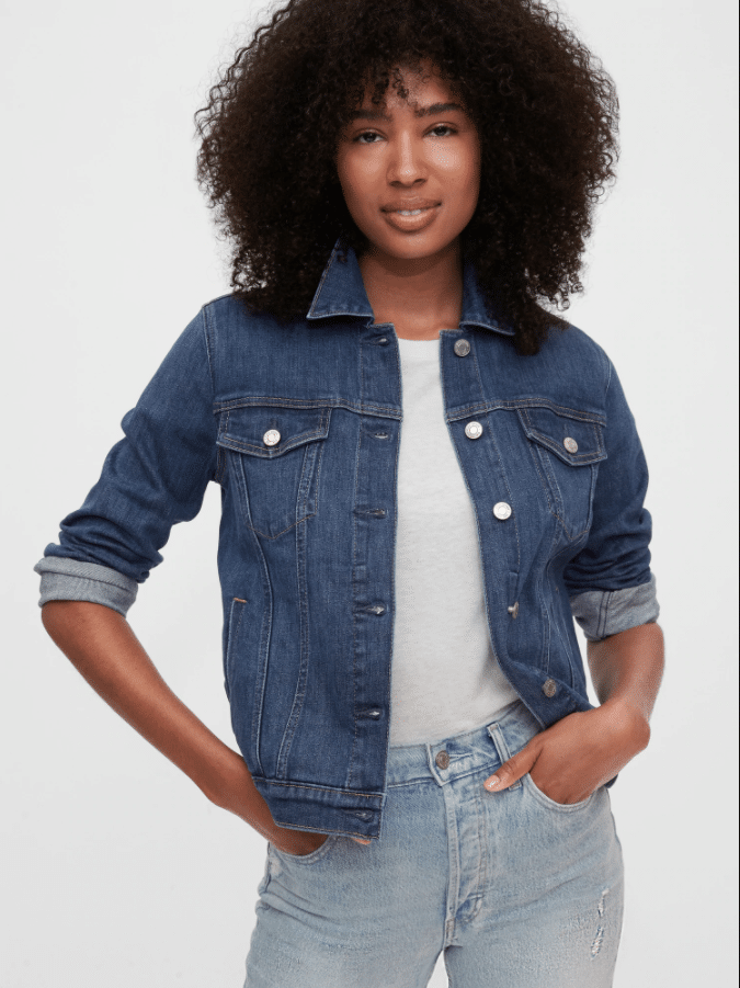 GAP Fall Faves Icon Denim Jacket. Featuring a Stretch denim material this fashionable Icon Denim Jacket is the perfect piece for your fall outfits. Pair it with a light-colored top or wear it over your favorite fall dress. This statement piece is a great way to stay warm, comfy, and fashionable this fall season.