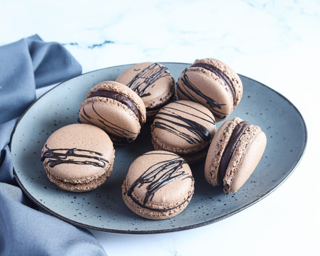 Chocolate Macarons with Salted Caramel Filling Holiday. These Chocolate Macarons with Salted Caramel Filling are a delight, so soft and full of flavor. Perfect for entertaining as well as sweet treat gifts to loved ones during the holidays.