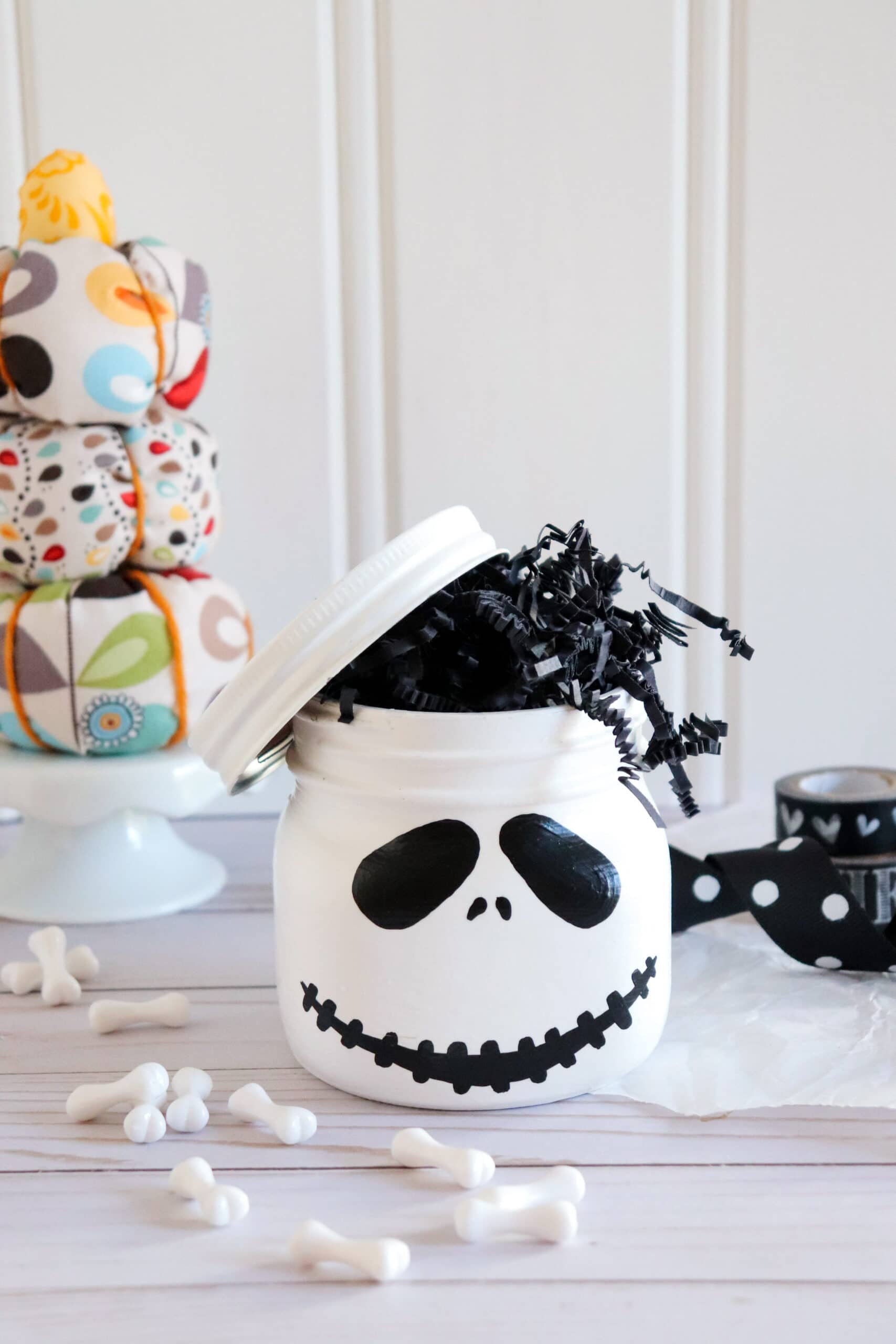 Jack Skellington Mason Jar. This Jack Skellington Mason Jar Halloween Craft is the perfect way to creep your way into the Halloween season. Fill it with your favorite candies and treats, it's the perfect Halloween Craft that you can keep or gift.