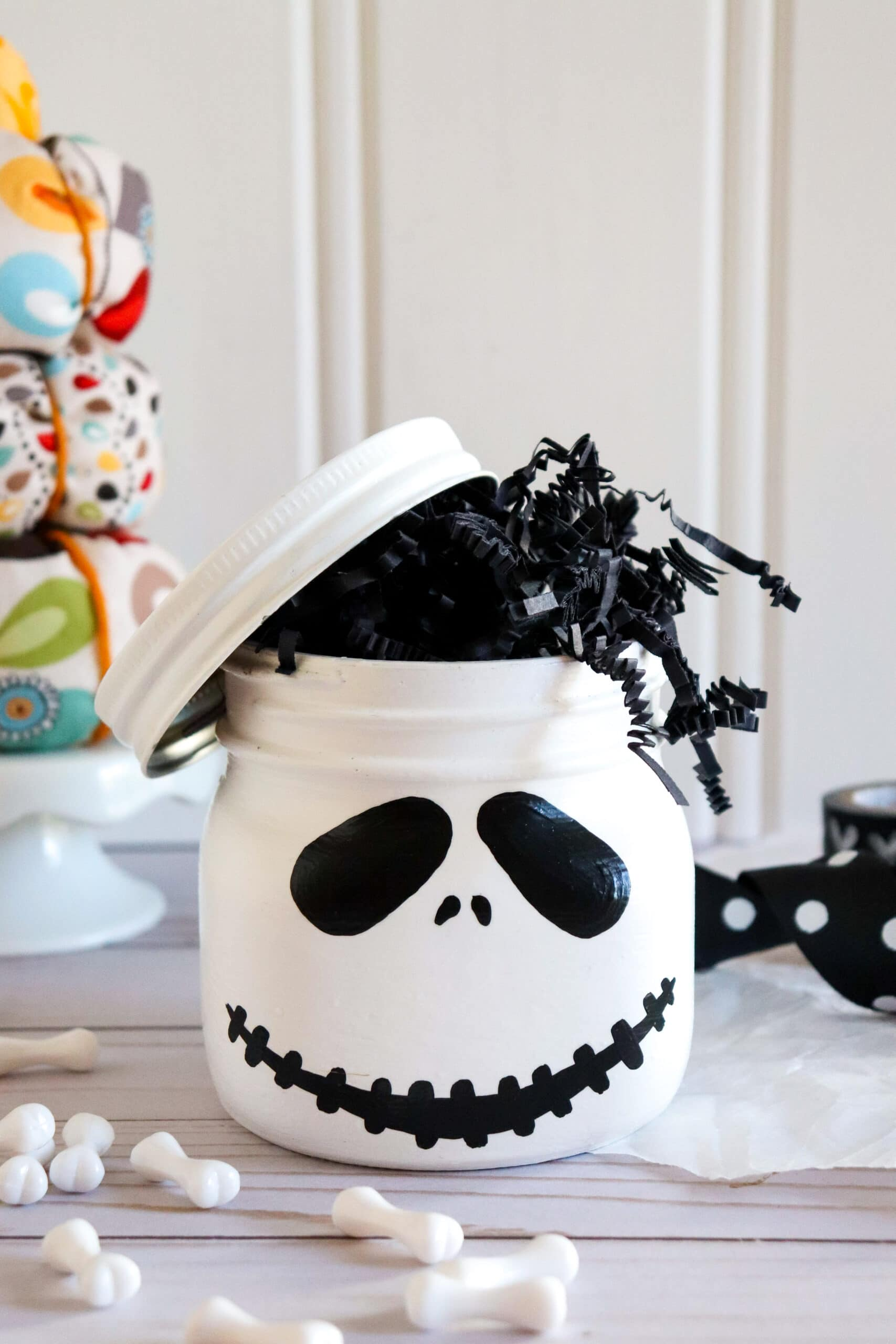 Jack Skellington Mason Jar Closeup. This Jack Skellington Mason Jar Halloween Craft is the perfect way to creep your way into the Halloween season. Fill it with your favorite candies and treats, it's the perfect Halloween Craft that you can keep or gift.