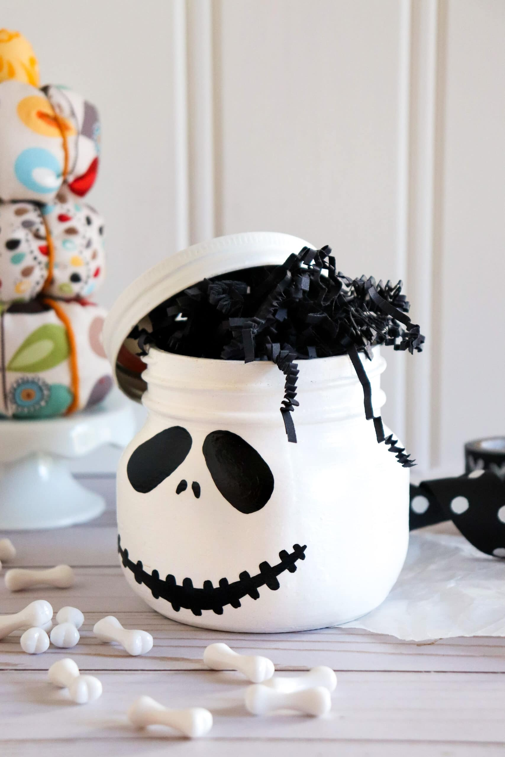 Jack Skellington Mason Jar Side. This Jack Skellington Mason Jar Halloween Craft is the perfect way to creep your way into the Halloween season. Fill it with your favorite candies and treats, it's the perfect Halloween Craft that you can keep or gift.