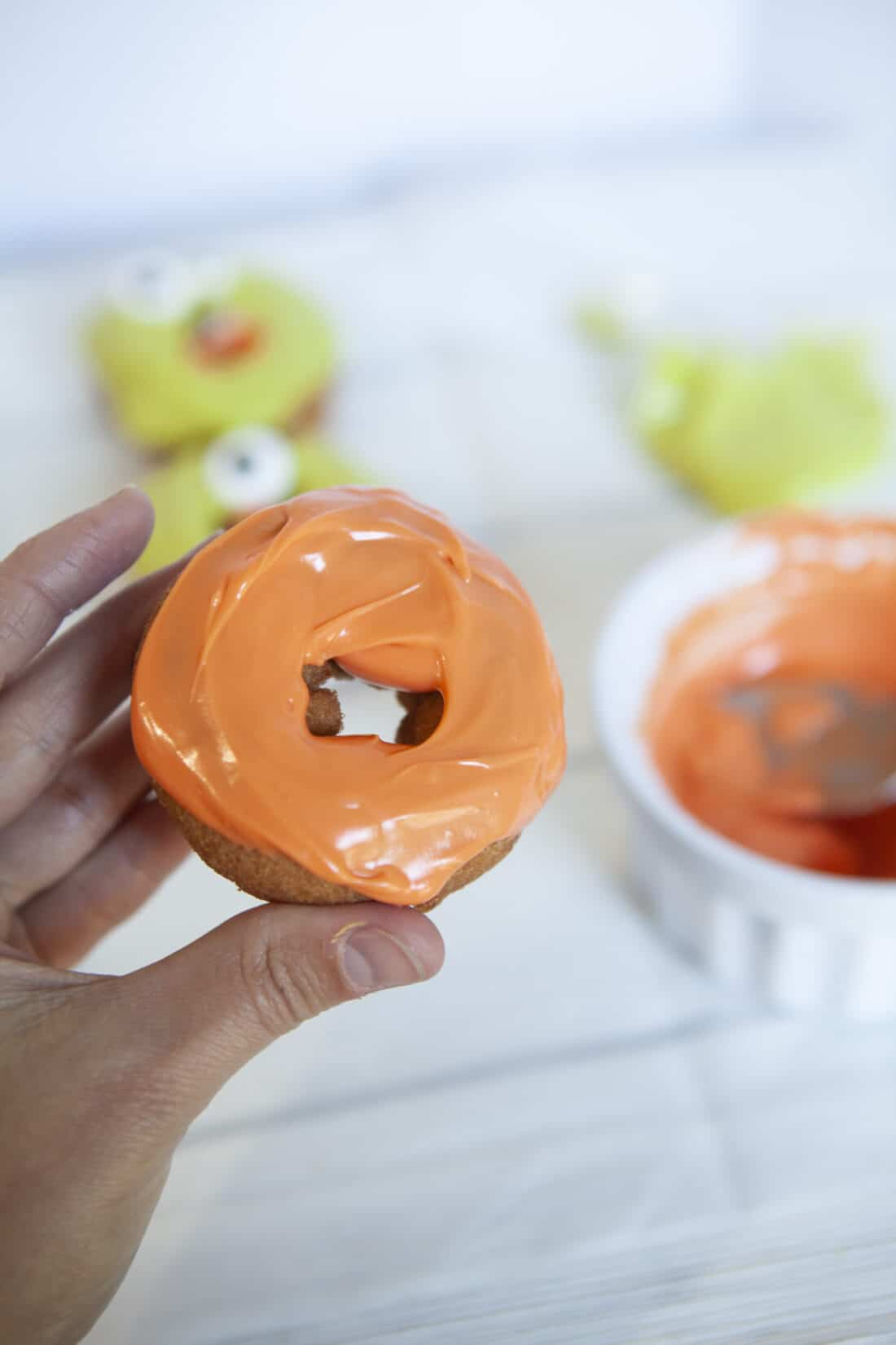Monster Donuts Orange Donut. Make these spooky cute Monster Donuts for your next Halloween event. Made with your favorite donuts as a base, you can create and decorate vampires, mummies, and other iconic edible Halloween monsters.