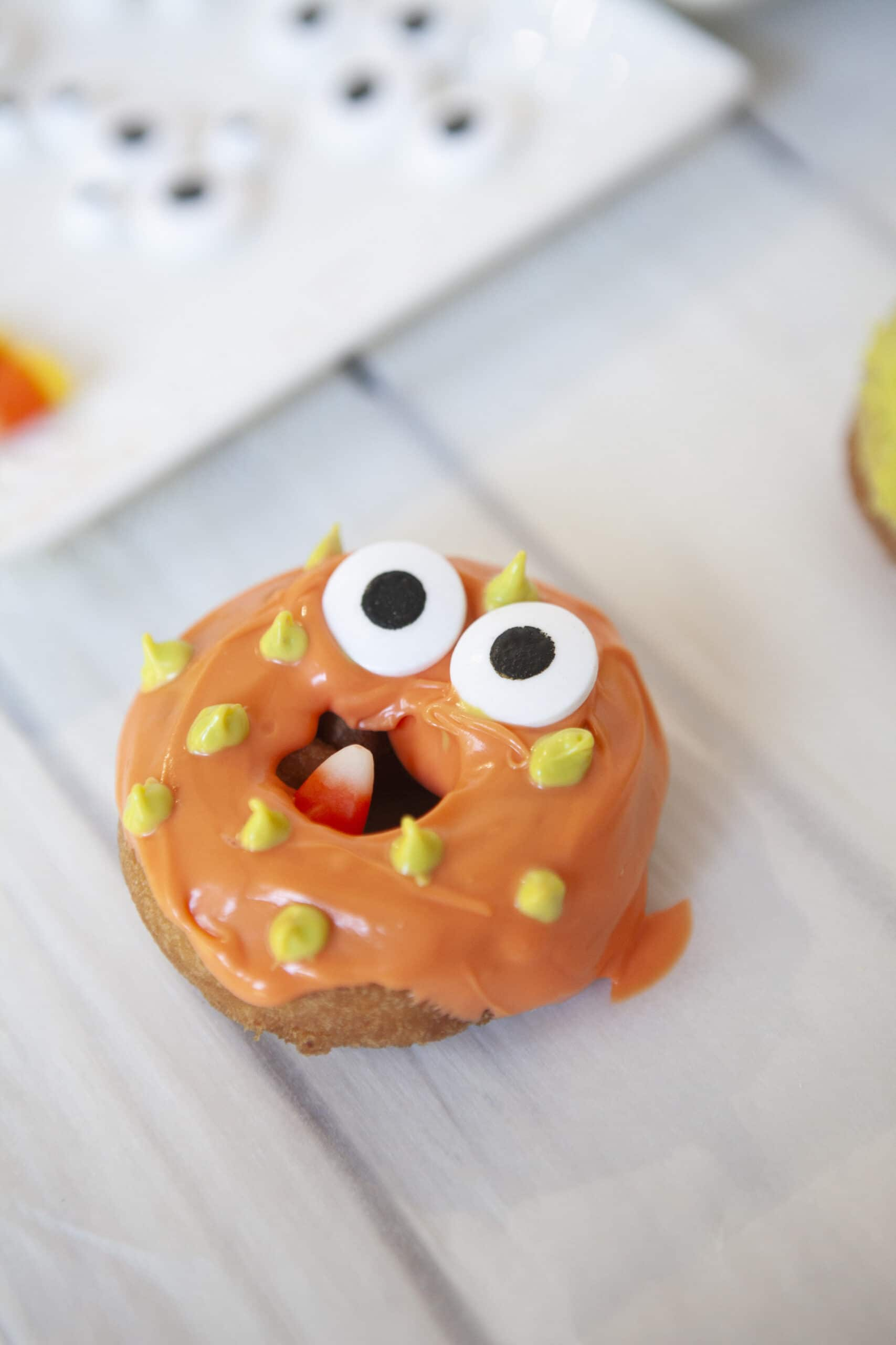 Monster Donuts Candy Corn Monster. Make these spooky cute Monster Donuts for your next Halloween event. Made with your favorite donuts as a base, you can create and decorate vampires, mummies, and other iconic edible Halloween monsters.