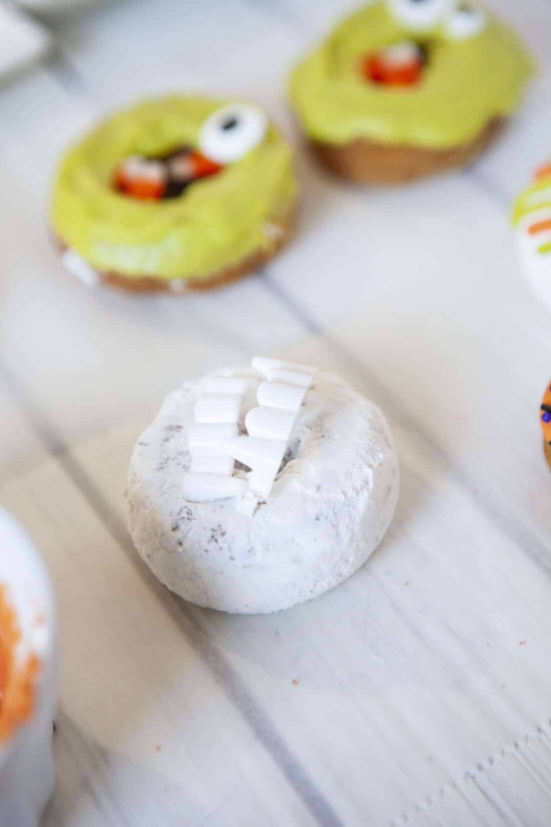 Monster Donuts Vampire. Make these spooky cute Monster Donuts for your next Halloween event. Made with your favorite donuts as a base, you can create and decorate vampires, mummies, and other iconic edible Halloween monsters.