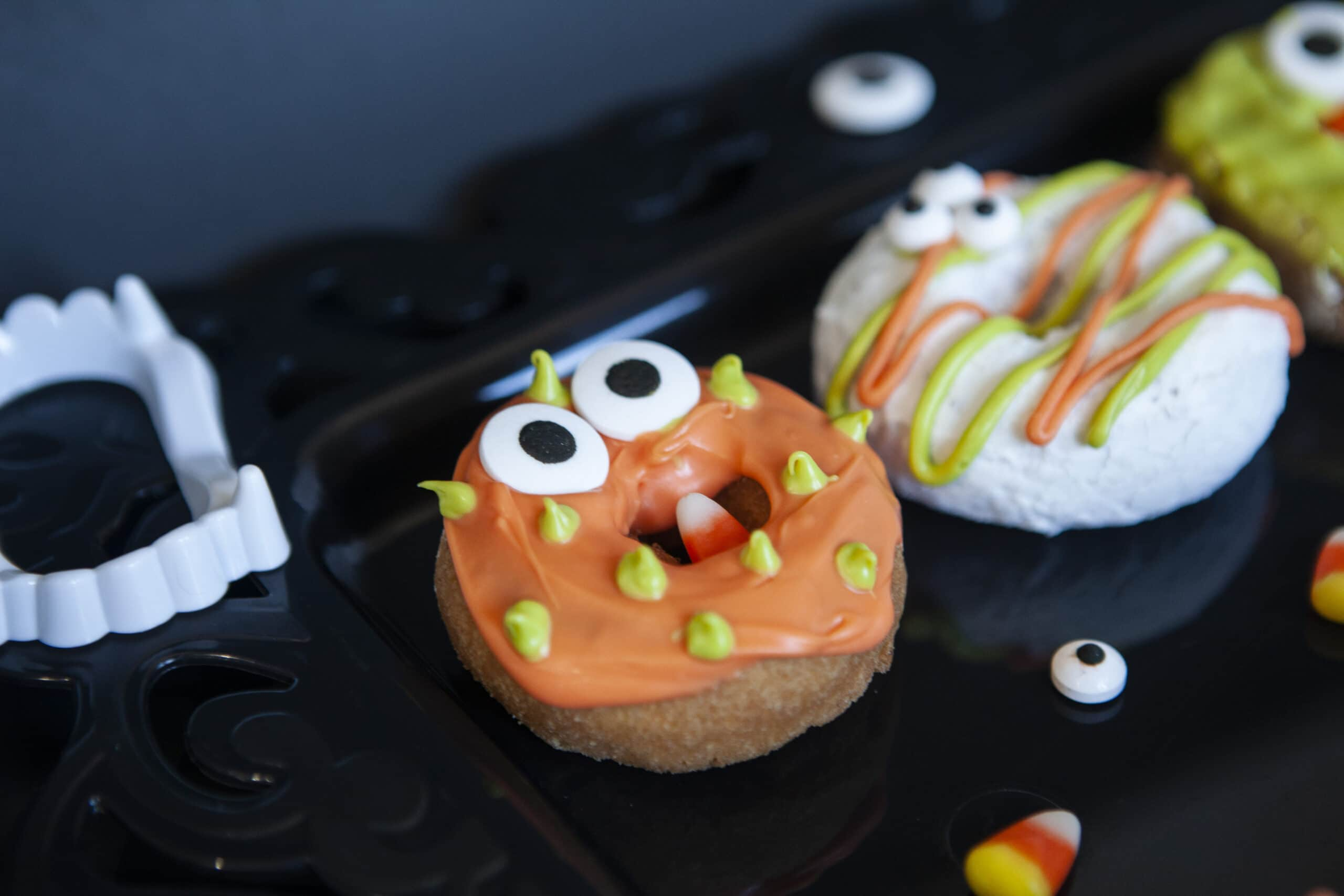Monster Donuts Monster Candy Corn. Make these spooky cute Monster Donuts for your next Halloween event. Made with your favorite donuts as a base, you can create and decorate vampires, mummies, and other iconic edible Halloween monsters.