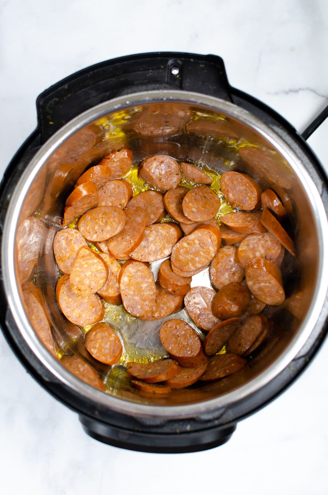 Instant Pot Andouille Sausage Jambalaya Step 1. An authentic Instant Pot Andouille Sausage Jambalaya recipe that can be made in 30 minutes! This flavorful easy one-pan jambalaya recipe is made with andouille sausage, bell peppers, onion, celery, and spices. It's an instant family favorite recipe that is perfect for busy nights.