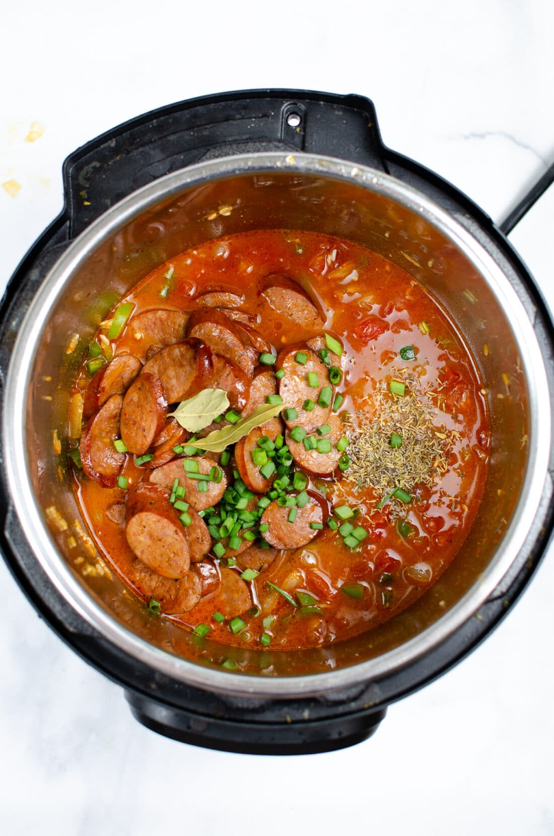 Instant Pot Andouille Sausage Jambalaya Step 6. An authentic Instant Pot Andouille Sausage Jambalaya recipe that can be made in 30 minutes! This flavorful easy one-pan jambalaya recipe is made with andouille sausage, bell peppers, onion, celery, and spices. It's an instant family favorite recipe that is perfect for busy nights.