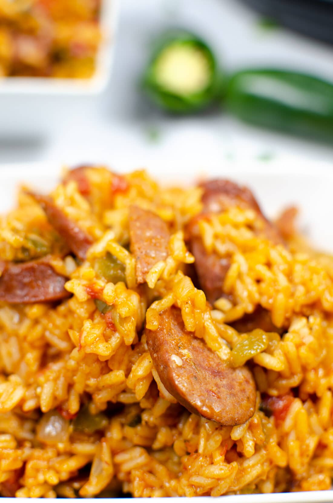 Closeup of Instant Pot Andouille Sausage Jambalaya. An authentic Instant Pot Andouille Sausage Jambalaya recipe that can be made in 30 minutes! This flavorful easy one-pan jambalaya recipe is made with andouille sausage, bell peppers, onion, celery, and spices. It's an instant family favorite recipe that is perfect for busy nights.