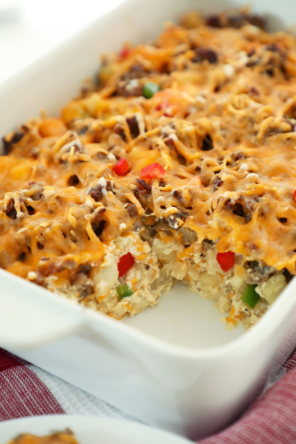 A delicious breakfast casserole without eggs. This sausage hashbrown breakfast casserole is a quick, easy, and delicious perfect breakfast for any holiday.