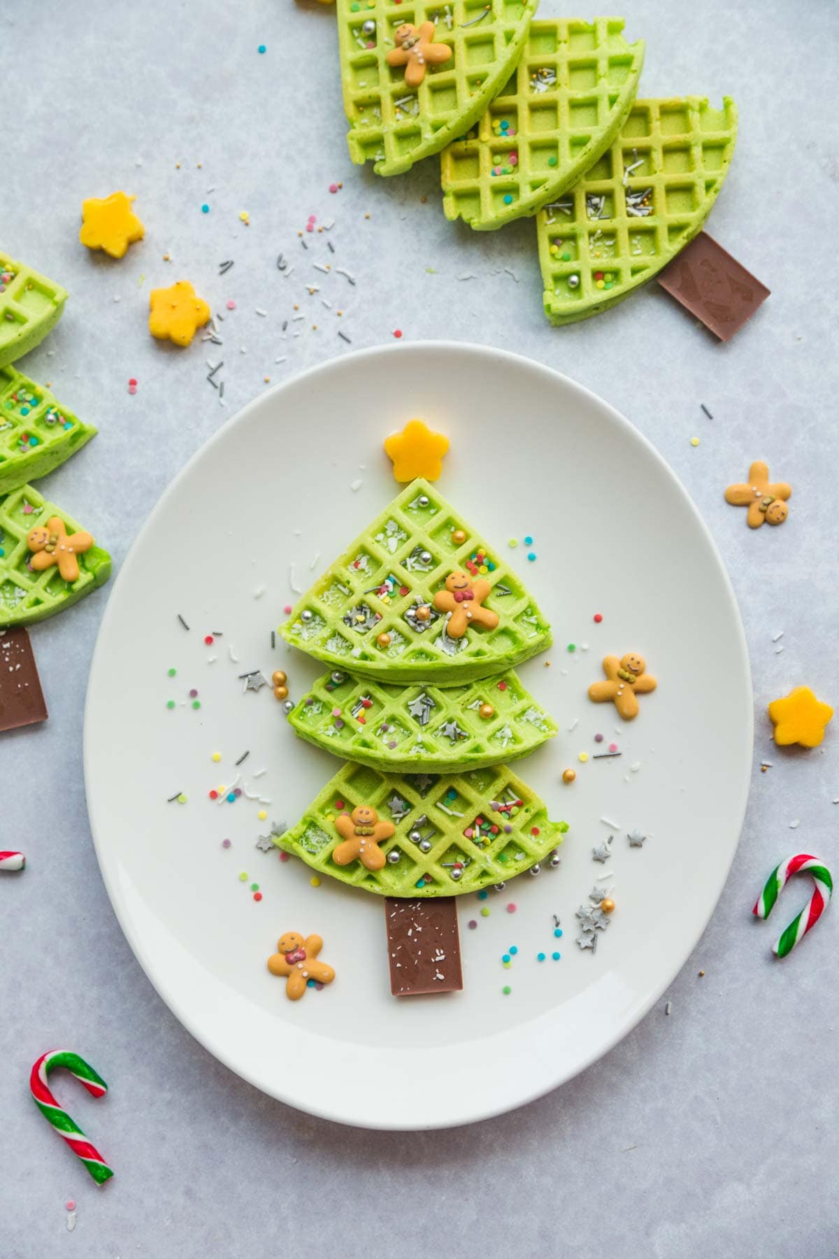 These are the cutest waffles that you will ever make! Green Christmas tree waffles make a fun Christmas breakfast that your kids are gonna love. So quick and easy to make, and the kids can decorate their own waffle Christmas trees.
