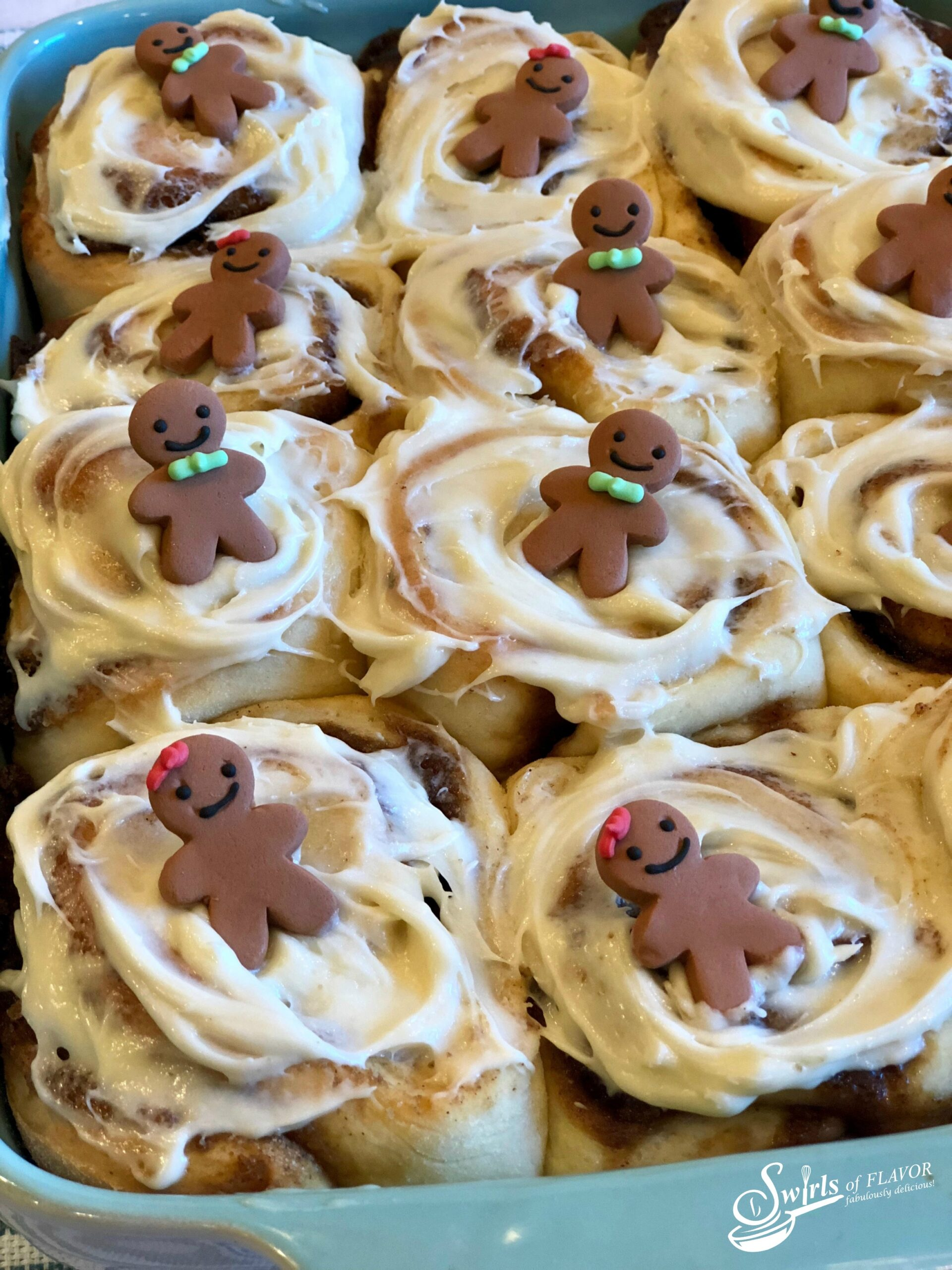 Gingerbread Cinnamon Rolls and Christmas morning and are a perfect match. Our Christmas Cinnamon Rolls is an easy recipe filled with gingerbread spices and brown sugar and topped with a silky cream cheese glaze.