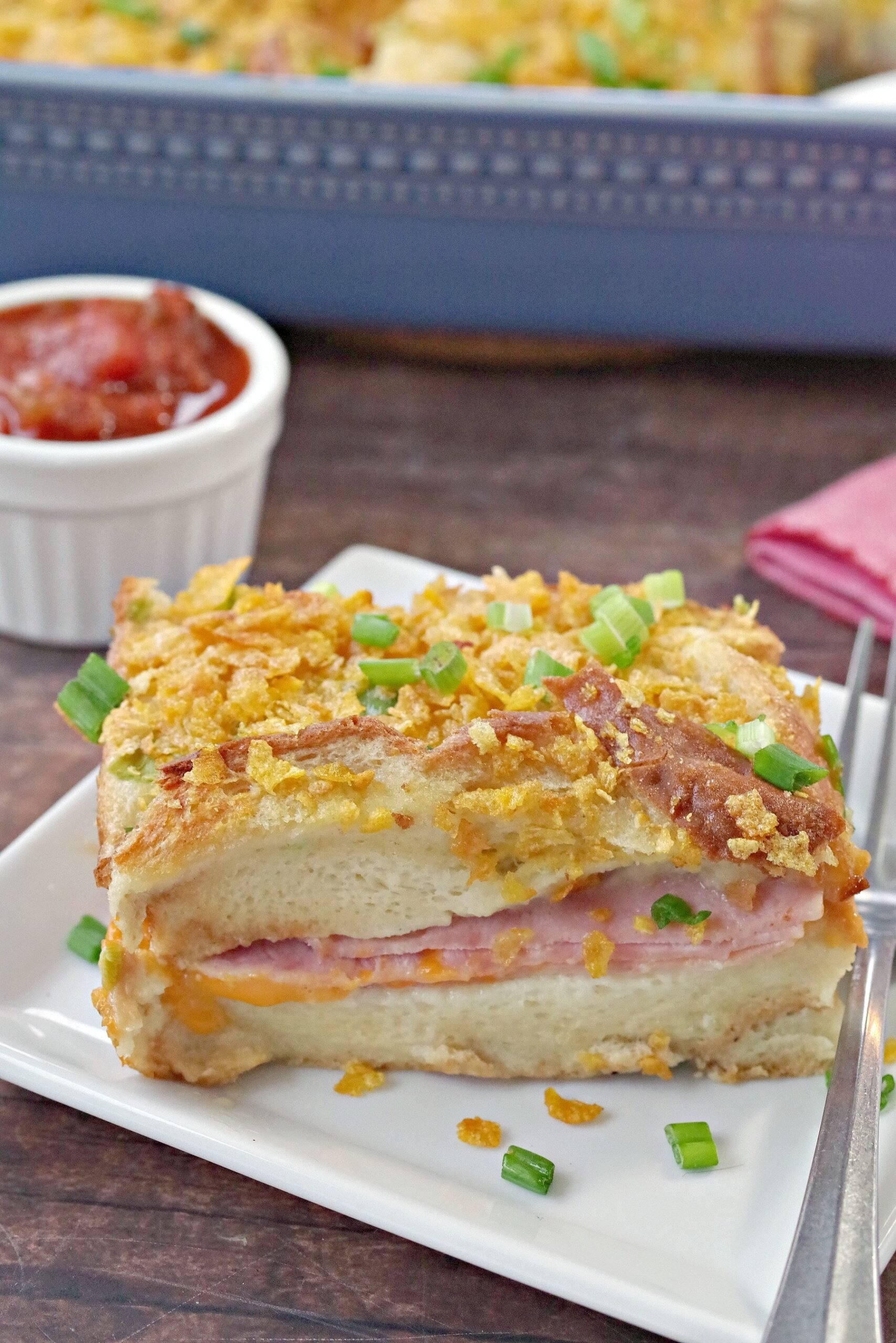 This Christmas Morning Casserole (also known as Wife Saver) is a savory overnight breakfast casserole with layers of bread, ham, cheese, eggs, and corn flakes. It's easy to throw together the night before and pop in the oven for a delicious Christmas morning brunch.