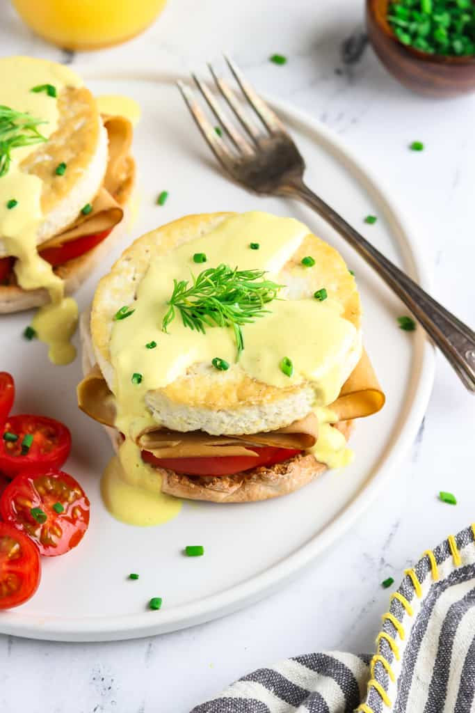 Vegan Eggs Benedict - reminiscent of a classic! Made with buttery English muffins that are piled-high with vegan ham, fried tofu eggs, and the creamiest hollandaise sauce you'll ever have! Plus, it'll be on your table in just 30 minutes or less.