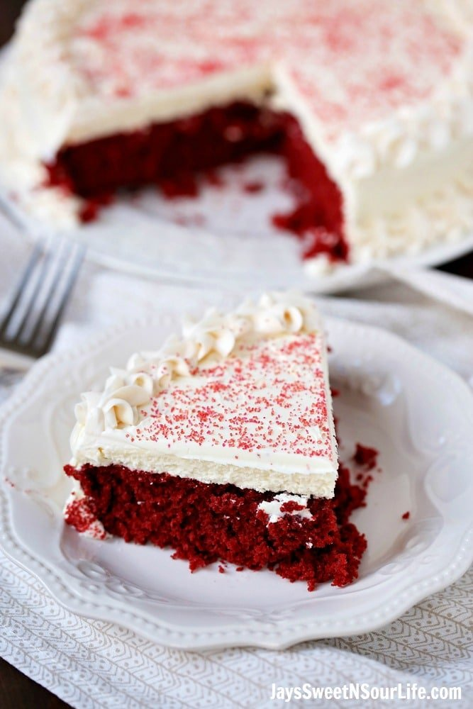 This beautiful 2 layered Red Velvet Cheesecake is made with a moist red velvet cake and a smooth, creamy cheesecake layer on the top. It's as if a cake and cheesecake had a baby, both layers made with love and topped with a cream cheese frosting.