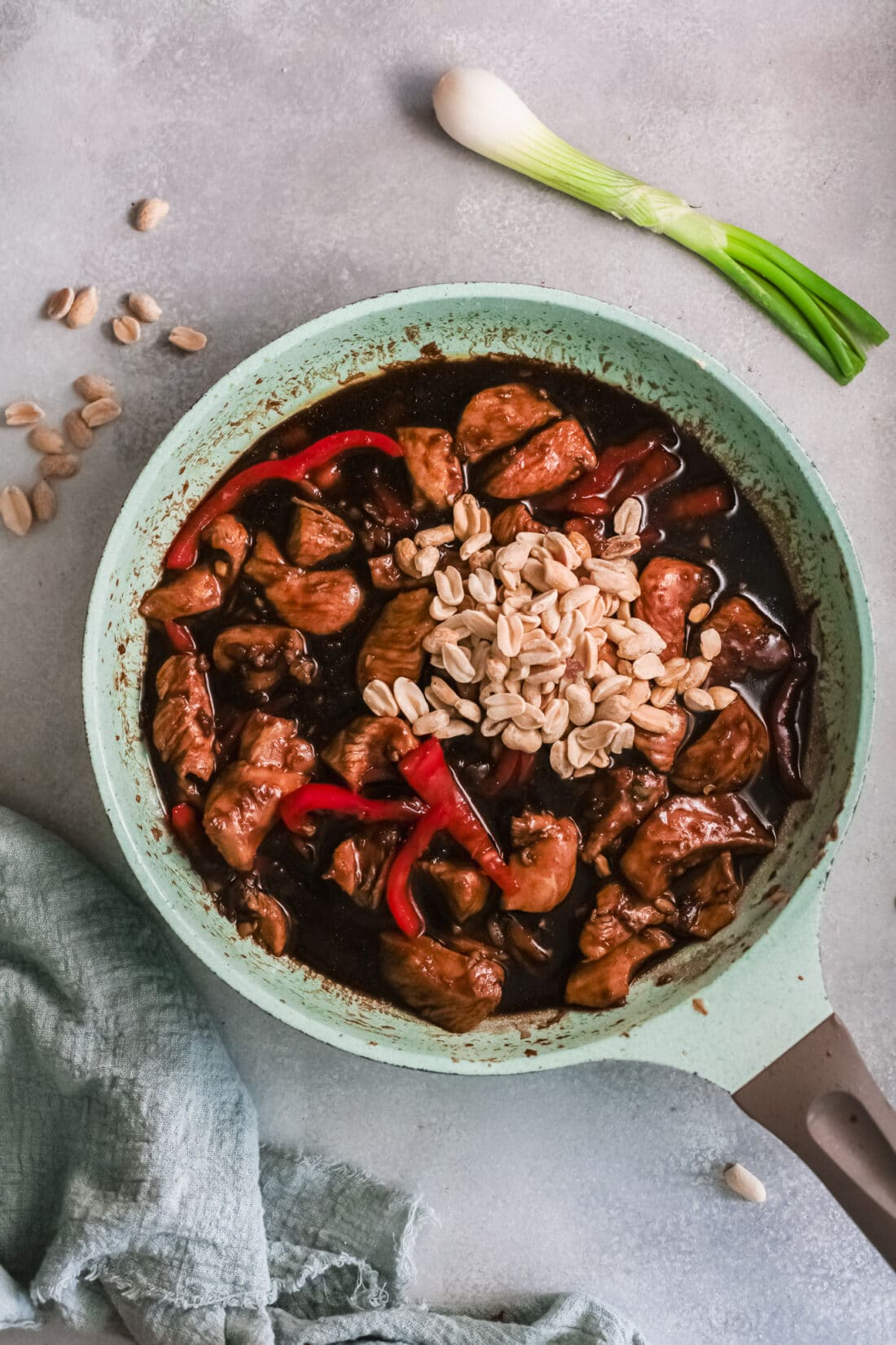 Better than Chinese takeout, make this Kung Pao Chicken at home. Cooking the peanuts in the kung pao chicken skillet.