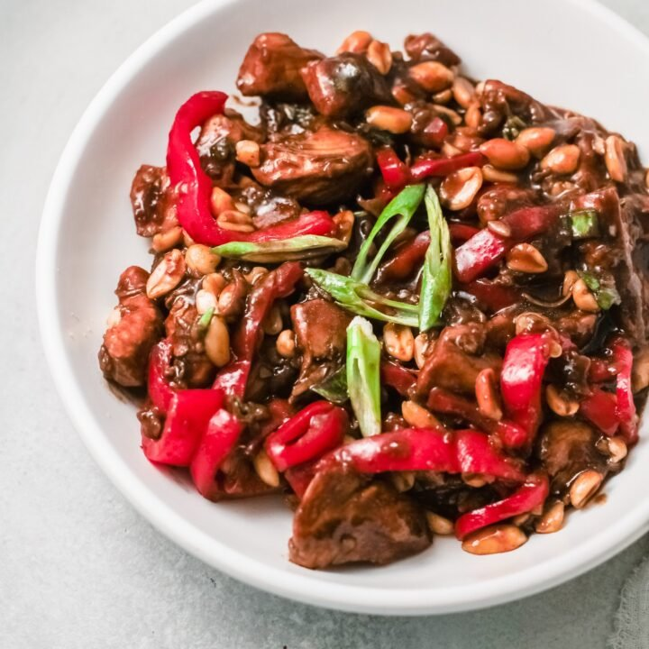 Better than Chinese takeout, make this Kung Pao Chicken at home. Up-close shot of the Kung Pao Chicken dish showcasing the fresh vegetables used in this dish along with the chicken in a savory sauce.