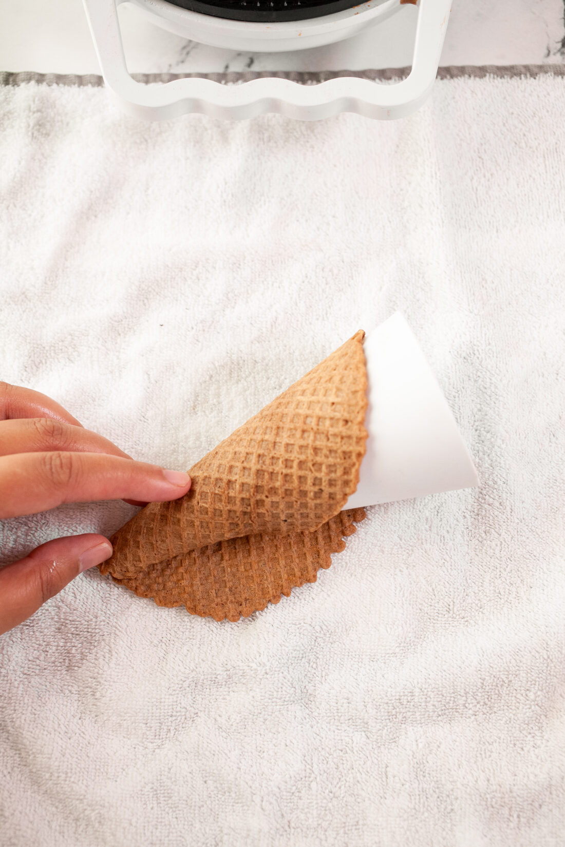 These Homemade Waffle Cones are quick and easy to make. Learn how to make waffle cones using a waffle iron, it's a simple recipe that you can top and fill with your favorite ice cream.