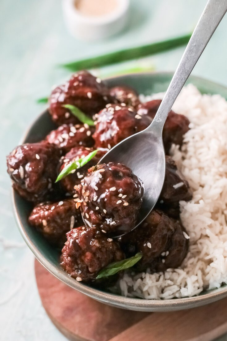 A savory Asian meatballs dish made with a sticky Mongolian glaze sauce. Made in only 30 minutes, this homemade restaurant-inspired Sticky Mongolian Meatballs recipe is a family favorite.