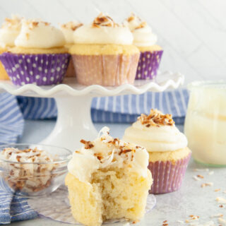 These light fluffy Toasted Coconut Cupcakes are topped with a decadent cream cheese frosting and then sprinkled with toasted coconut. A soft and tender coconut cupcake recipe that's super quick and easy to make!
